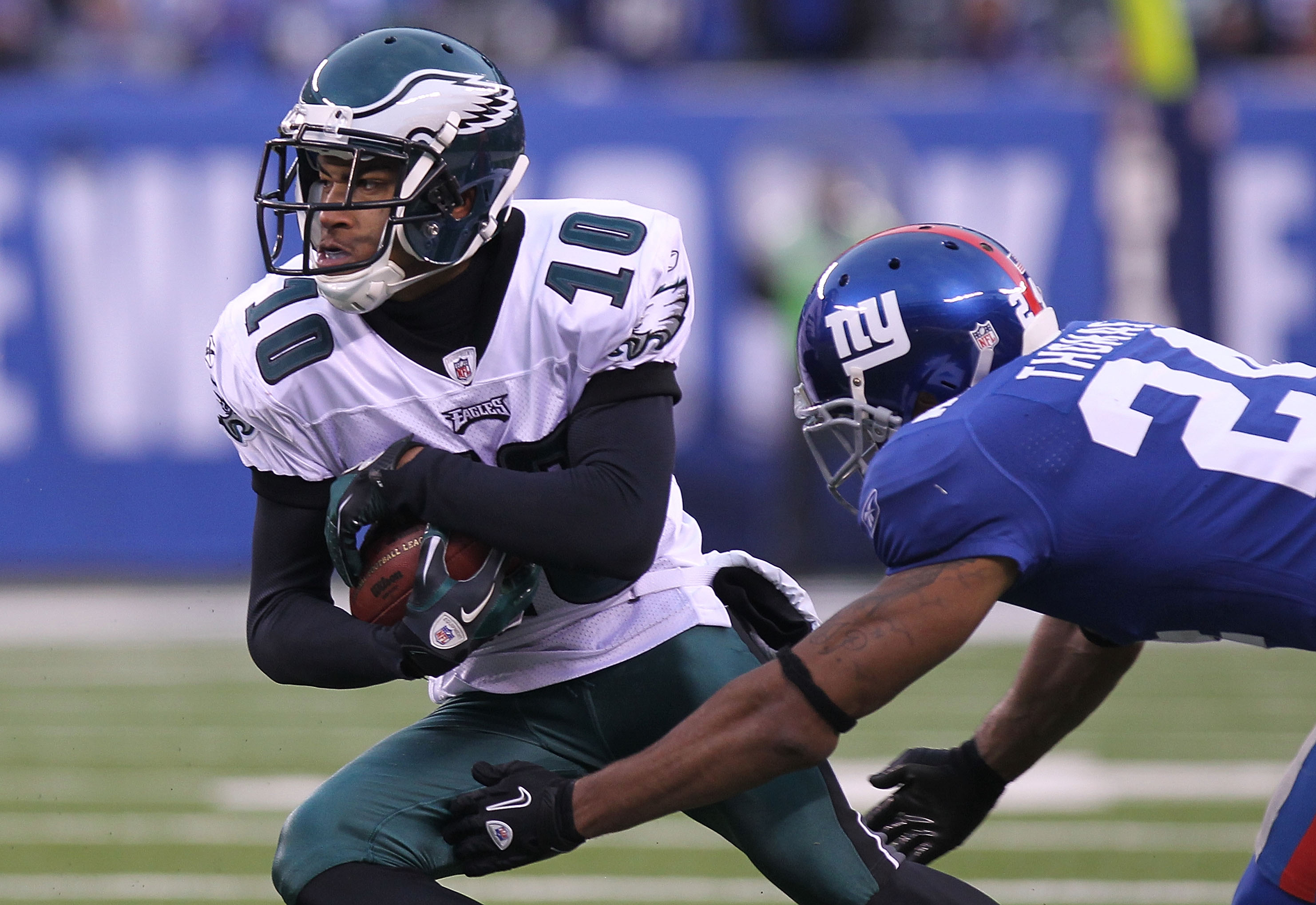 EAST RUTHERFORD, NJ - DECEMBER 19:  DeSean Jackson #10 of the Philadelphia Eagles eludes the tackle of Terrell Thomas #24 of the New York Giants at New Meadowlands Stadium on December 19, 2010 in East Rutherford, New Jersey.  (Photo by Nick Laham/Getty Im