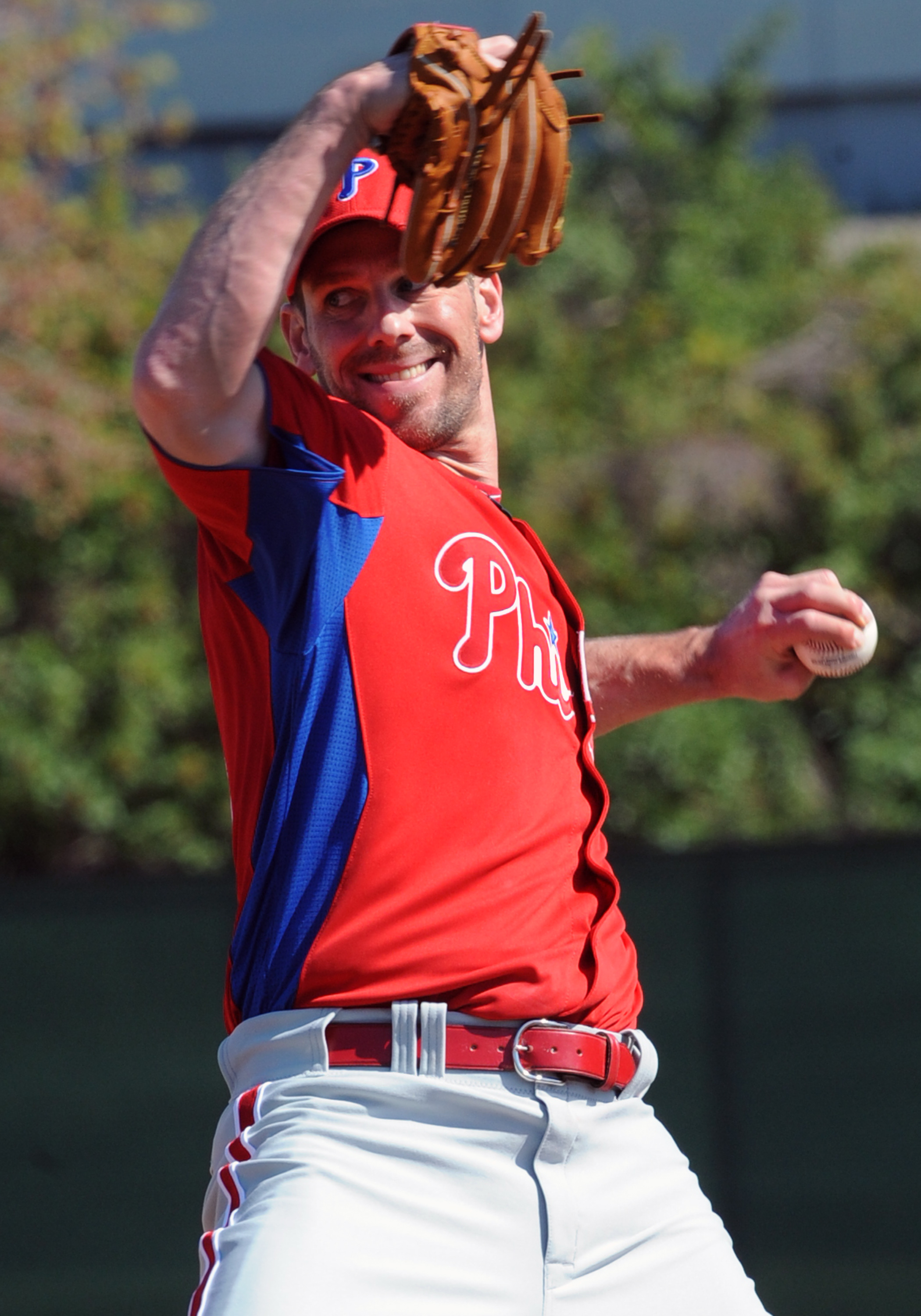 CLEARWATER, FL - FEBRUARY 19: Pitcher Cliff Lee #33 of the Philadelphia Phillies throws from the mound during a spring training workout February 19, 2011 the Carpenter Complex at Bright House Field in Clearwater, Florida. (Photo by Al Messerschmidt/Getty