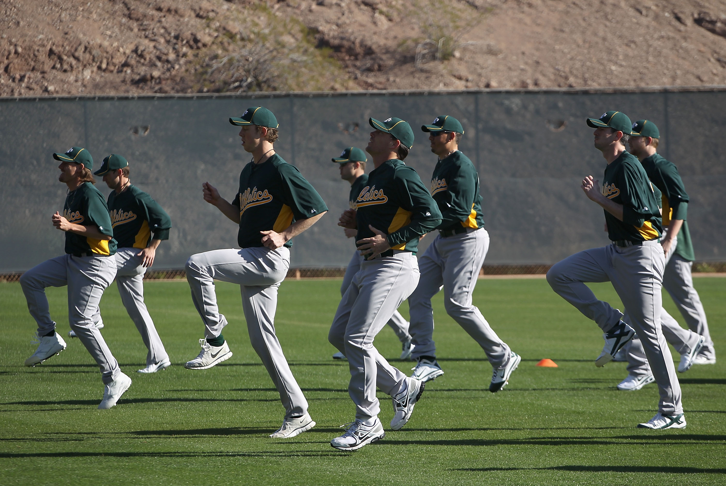 PHOENIX, AZ - FEBRUARY 16:  Pitchers for the Oakland Athletics warm up during a MLB spring training practice at Phoenix Municipal Stadium on February 16, 2011 in Phoenix, Arizona.  (Photo by Christian Petersen/Getty Images)