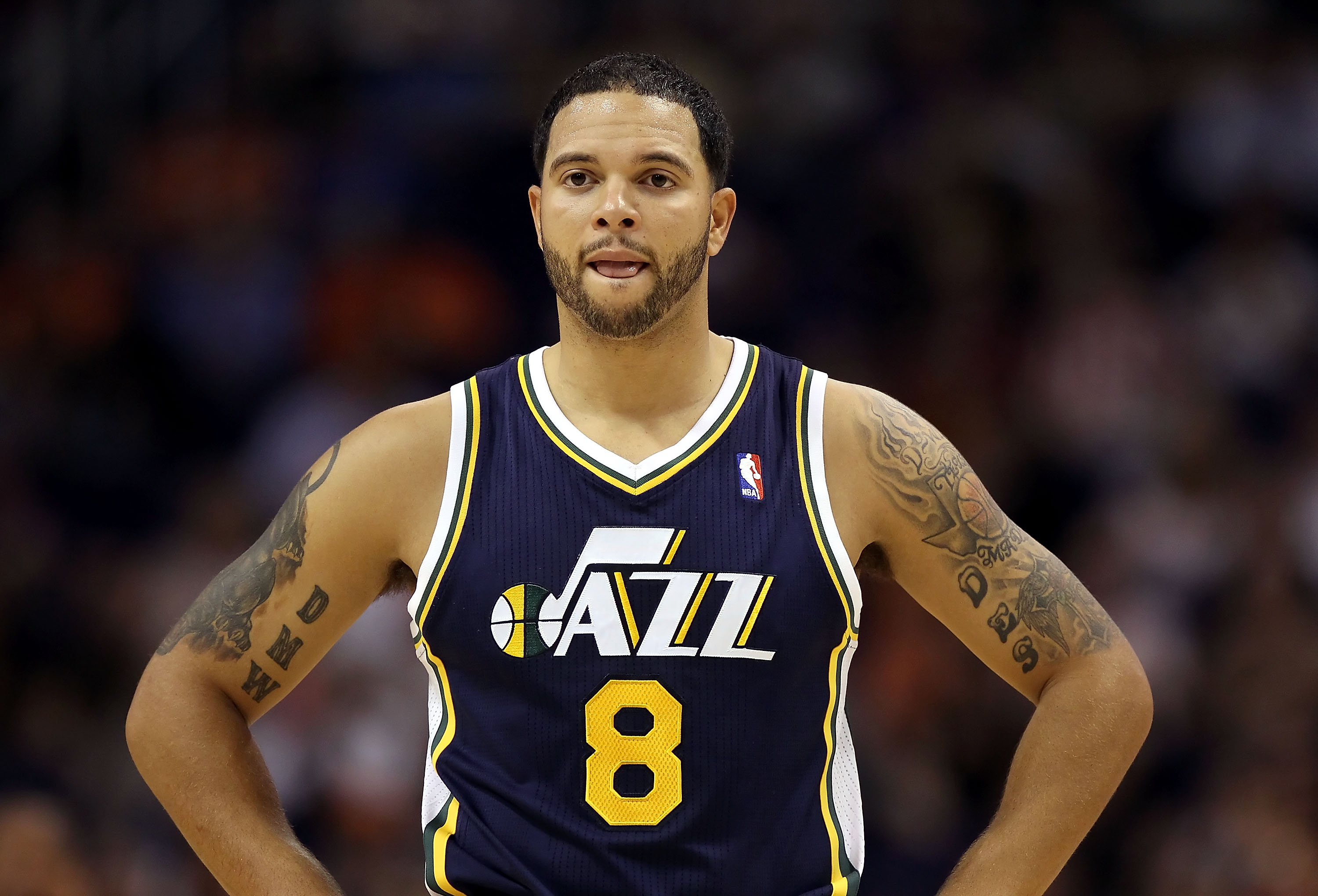 PHOENIX - OCTOBER 12:  Deron Williams #8 of the Utah Jazz in action during the preseason NBA game against the Phoenix Suns at US Airways Center on October 12, 2010 in Phoenix, Arizona. NOTE TO USER: User expressly acknowledges and agrees that, by download