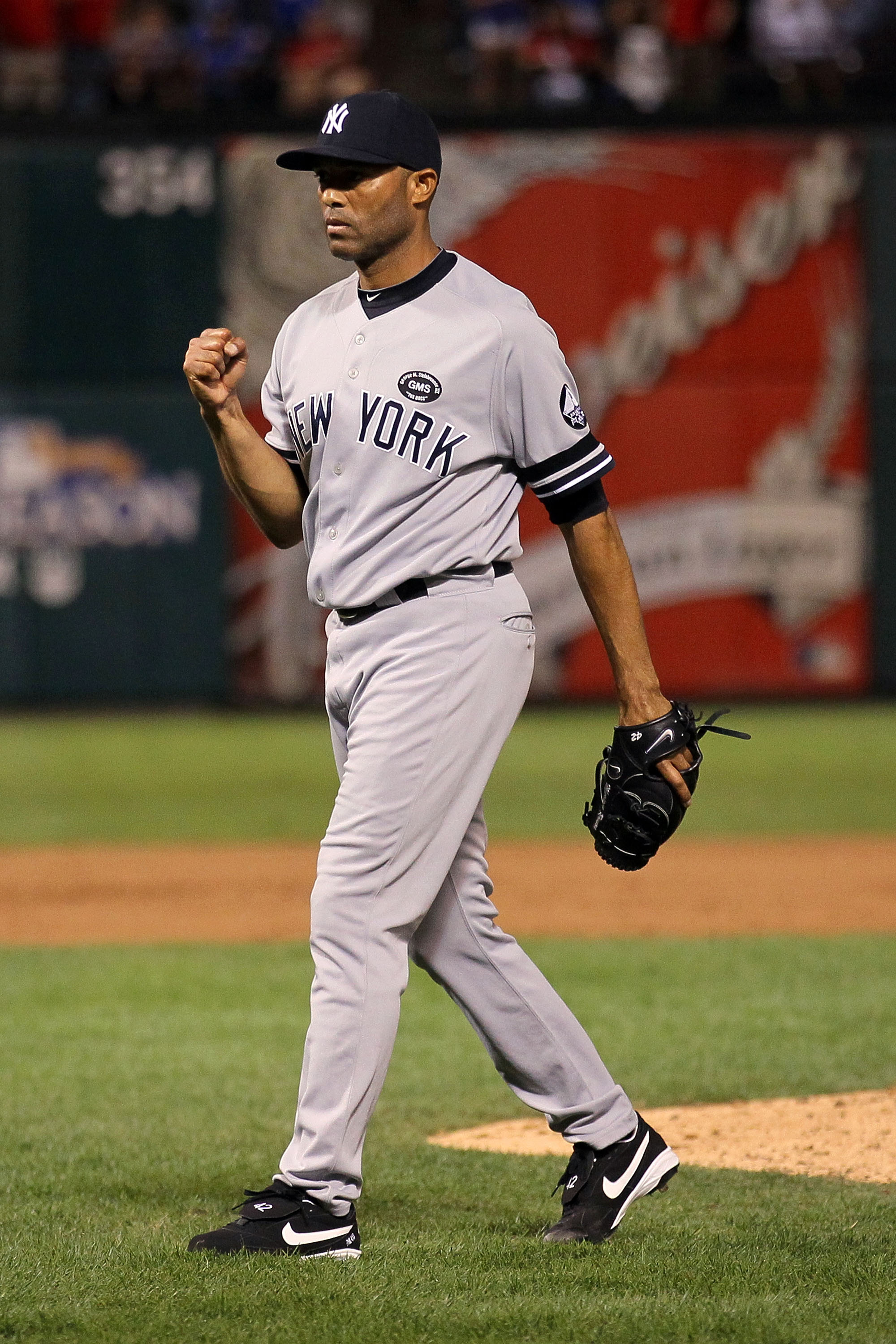 ARLINGTON, TX - OCTOBER 15:  Mariano Rivera #42 of the New York Yankees celebrates after defeating the Texas Rangers by a score of 6-5 to win Game One of the ALCS during the 2010 MLB Playoffs at Rangers Ballpark in Arlington on October 15, 2010 in Arlingt