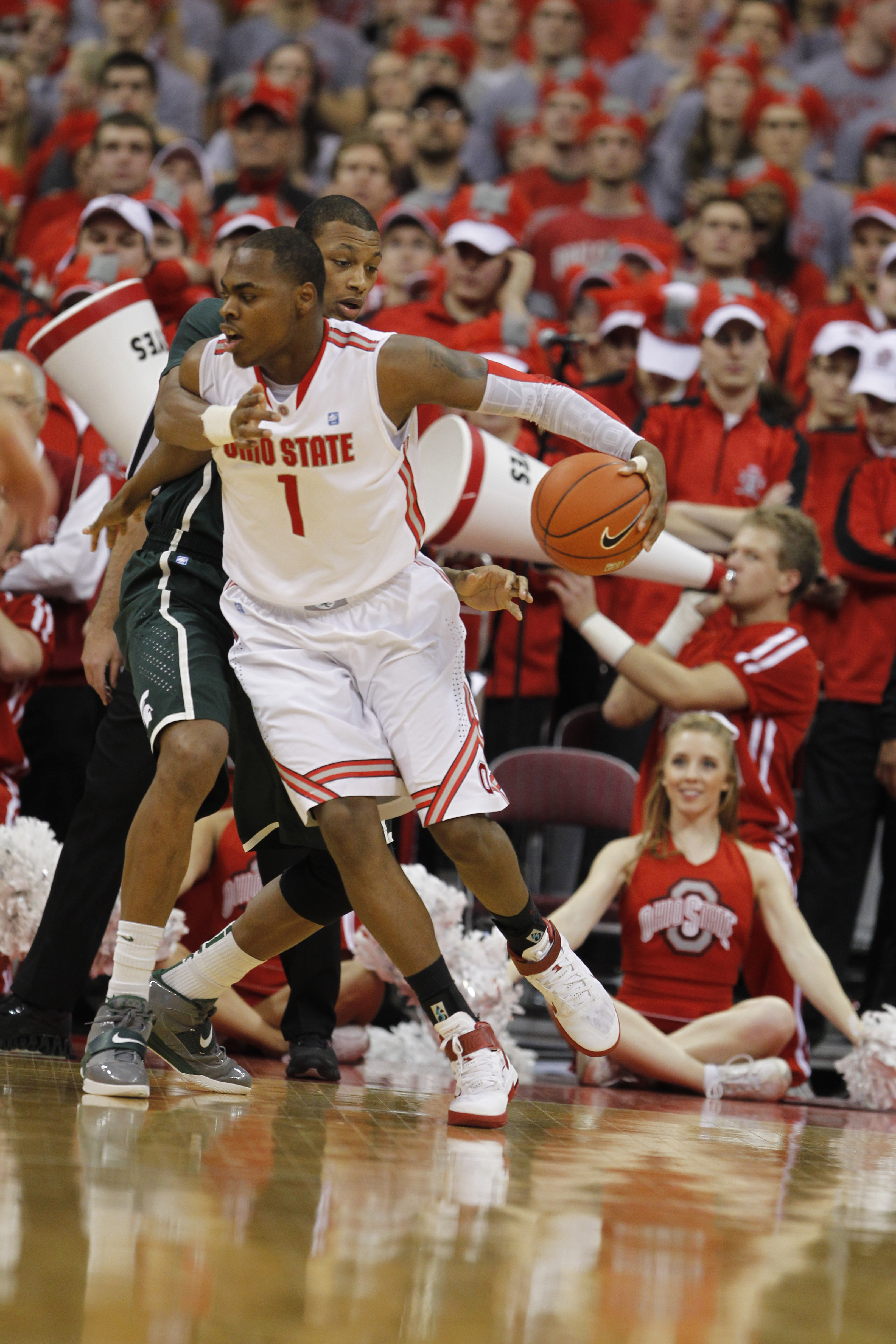COLUMBUS, OH - FEBRUARY 15:  Deshaun Thomas #1 of the Ohio State Buckeyes controls the ball while playing the Michigan State Spartans on February 15, 2011 at Value City Arena in Columbus, Ohio.  (Photo by Gregory Shamus/Getty Images)
