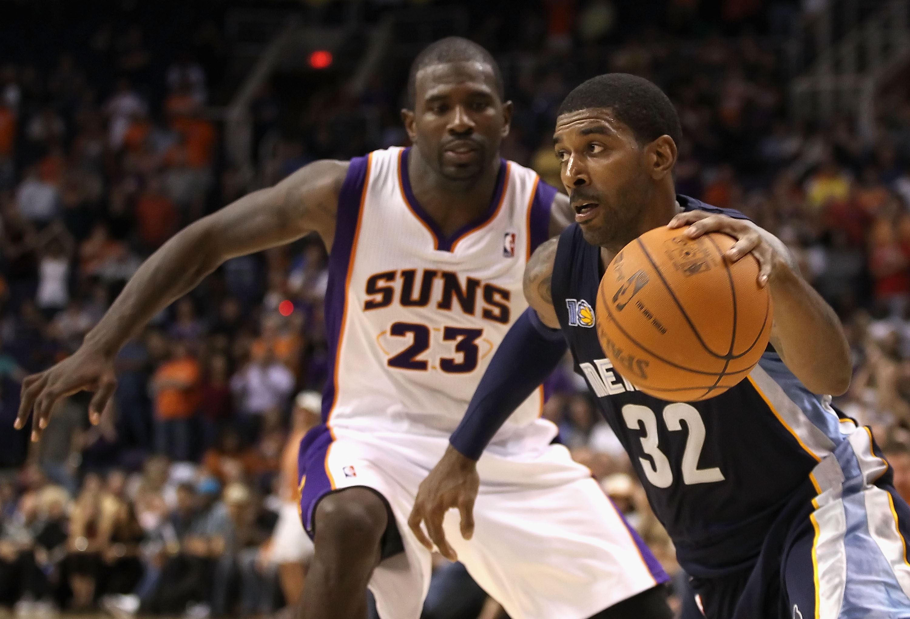 PHOENIX - NOVEMBER 05:  O.J. Mayo #32 of the Memphis Grizzlies drives the ball past Jason Richardson #23 of the Phoenix Suns during the NBA game at US Airways Center on November 5, 2010 in Phoenix, Arizona. The Suns defeated the Grizzlies 123-118 in doubl