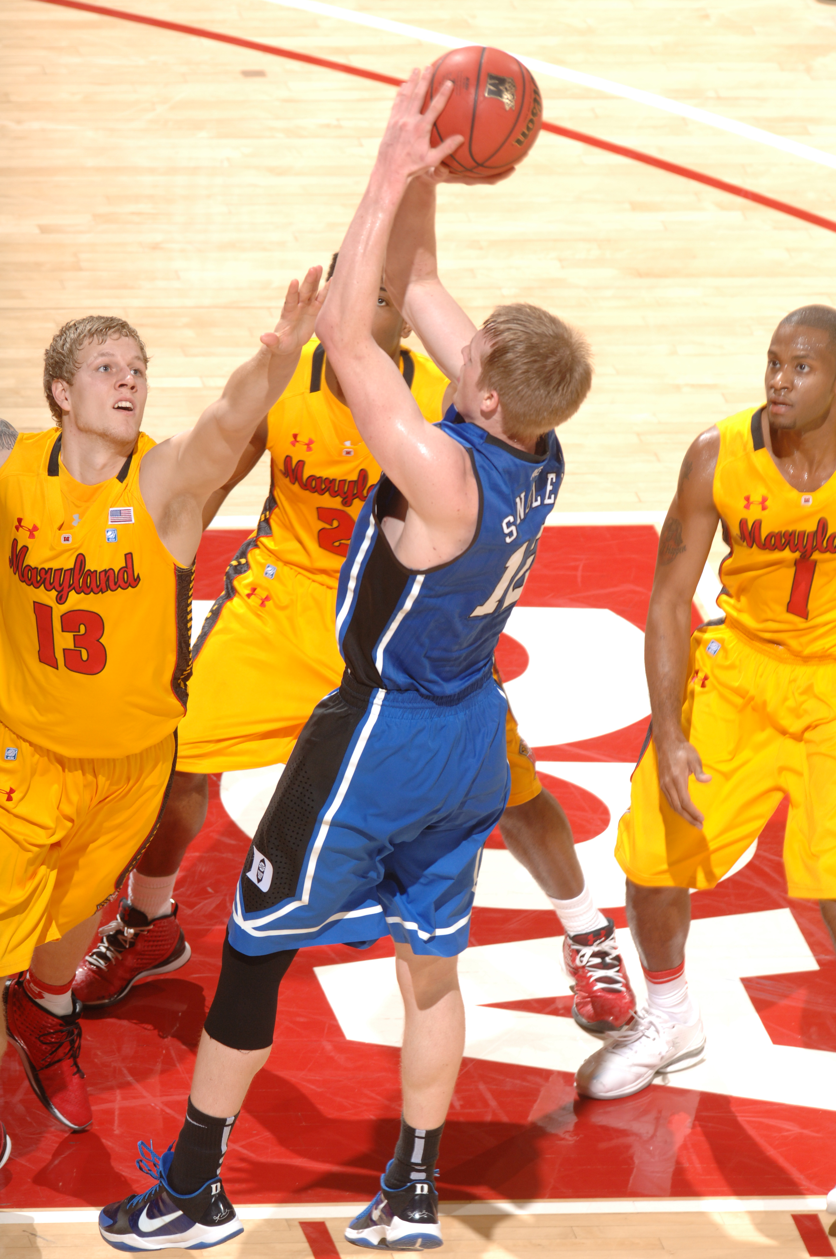 COLLEGE PARK, MD - FEBRUARY 2: Kyle Singler #12 of the Duke Blue Devils takes a jump shot during a college basketball game against the Maryland Terrapins on February 2, 2011 at the Comcast Arena in College Park, Maryland. The Blue Devils won 80-62. (Photo