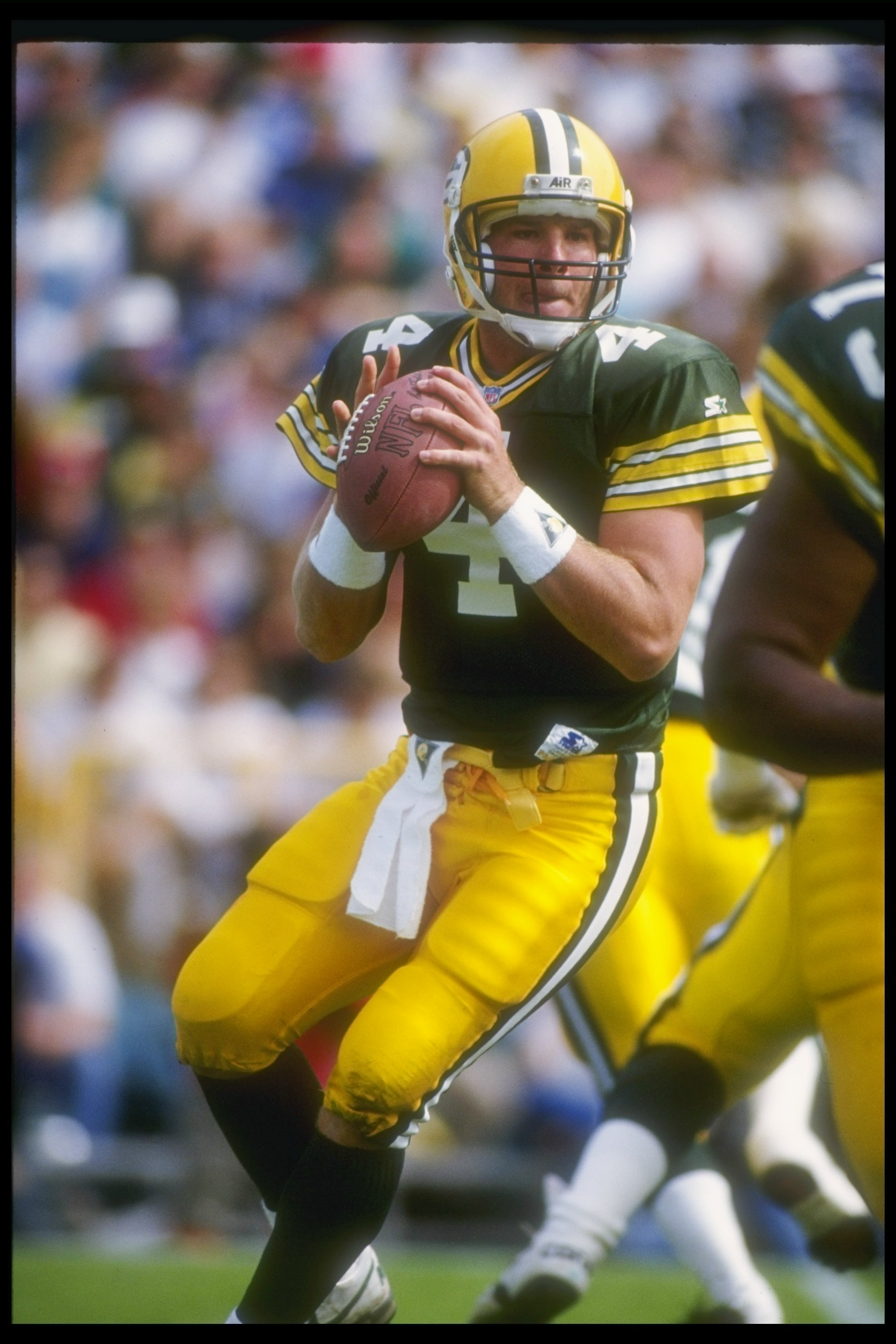 20 Sep 1992:  Quarterback Brett Favre of the Green Bay Packers looks to pass the ball during a game against the Cincinnati Bengals at Lambeau Field in Green Bay, Wisconsin.  The Packers won the game, 24-23. Mandatory Credit: Jonathan Daniel  /Allsport