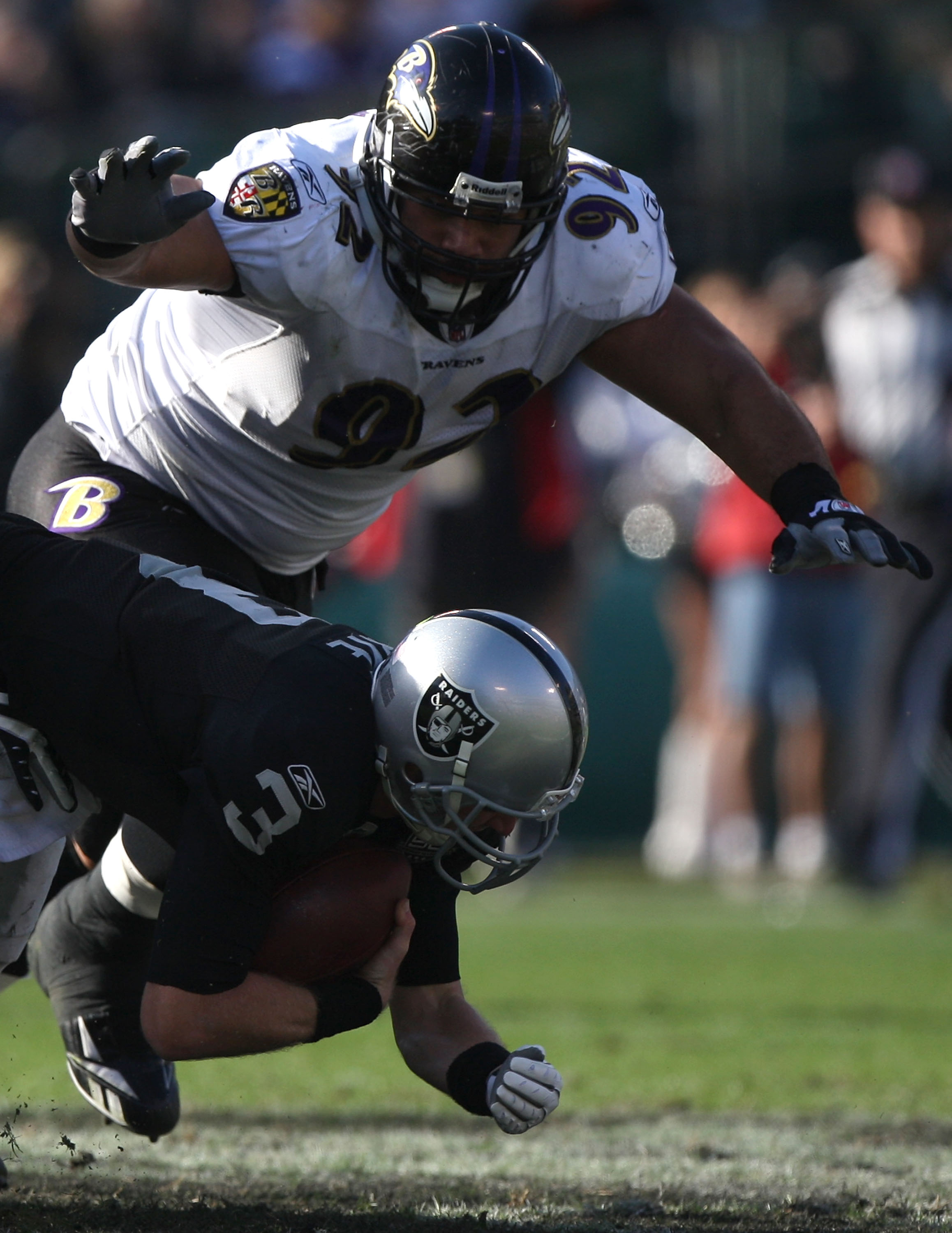 OAKLAND, CA - JANUARY 3: Haloti Ngata #92 of the Baltimore Ravens sacks Charlie Fry #3 of the Oakland Raiders during an NFL game at Oakland-Alameda County Coliseum on January 3, 2010 in Oakland, California. (Photo by Jed Jacobsohn/Getty Images)