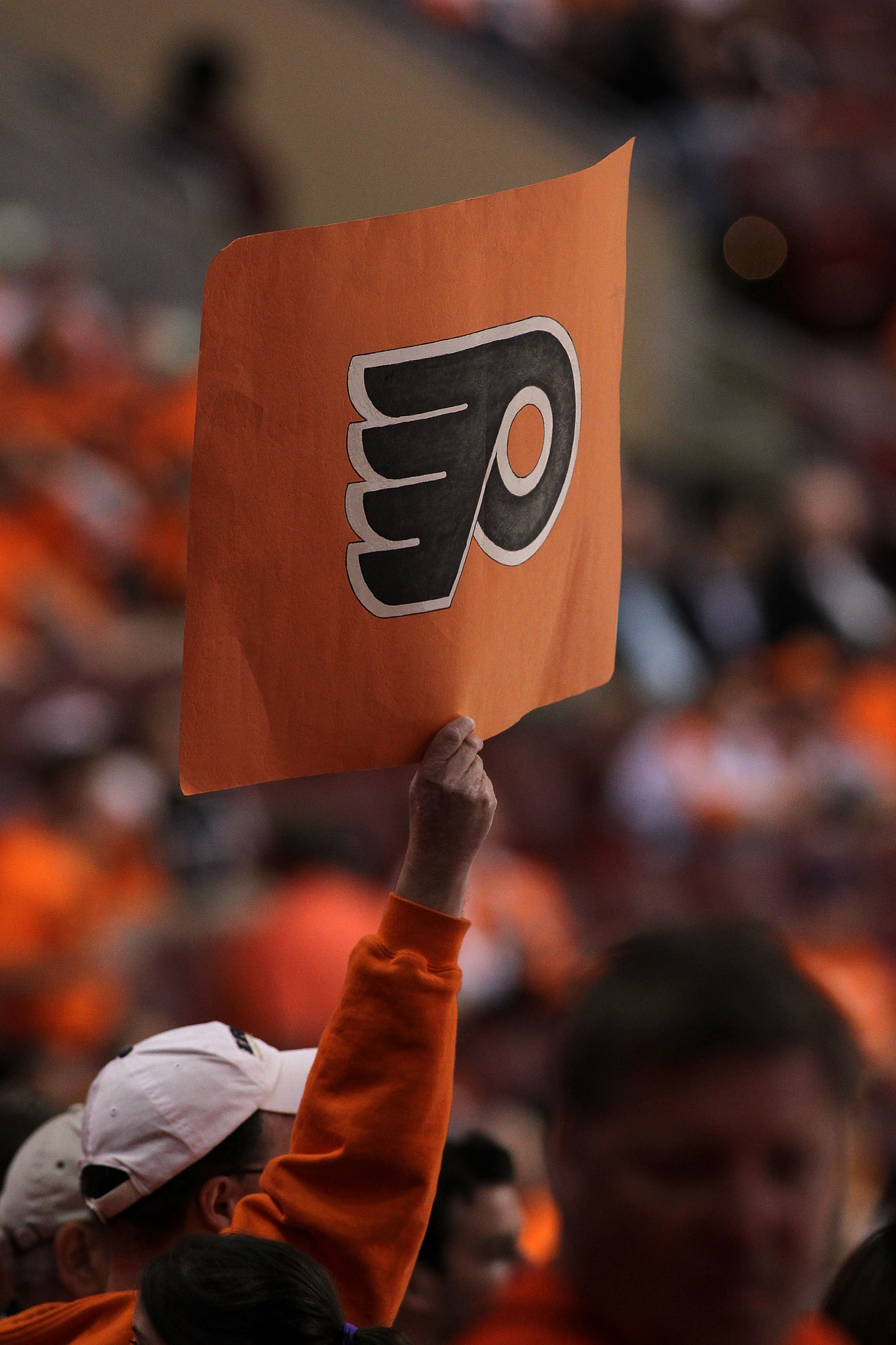 PHILADELPHIA - JUNE 02:  An fan holds up a Flyers logo before Game Three of the 2010 NHL Stanley Cup Final between the Chicago Blackhawks and the Philadelphia Flyers at Wachovia Center on June 2, 2010 in Philadelphia, Pennsylvania.  (Photo by Andre Ringue
