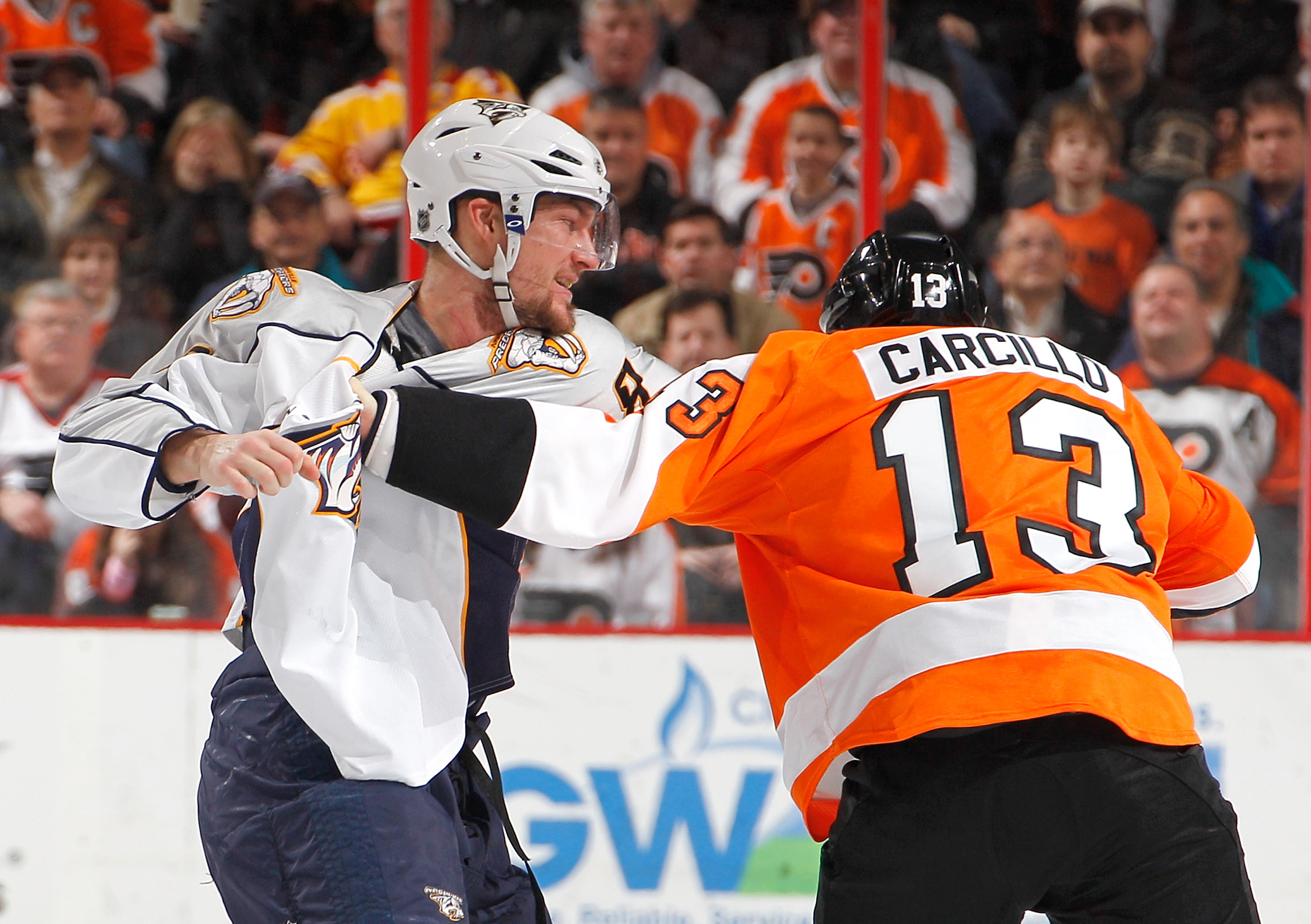 PHILADELPHIA, PA - FEBRUARY 03:  Alexander Sulzer #52 of the Nashville Predators fights with Daniel Carcillo #13 of the Philadelphia Flyers during the second period of an NHL hockey game at the Wells Fargo Center on February 3, 2011 in Philadelphia, Penns