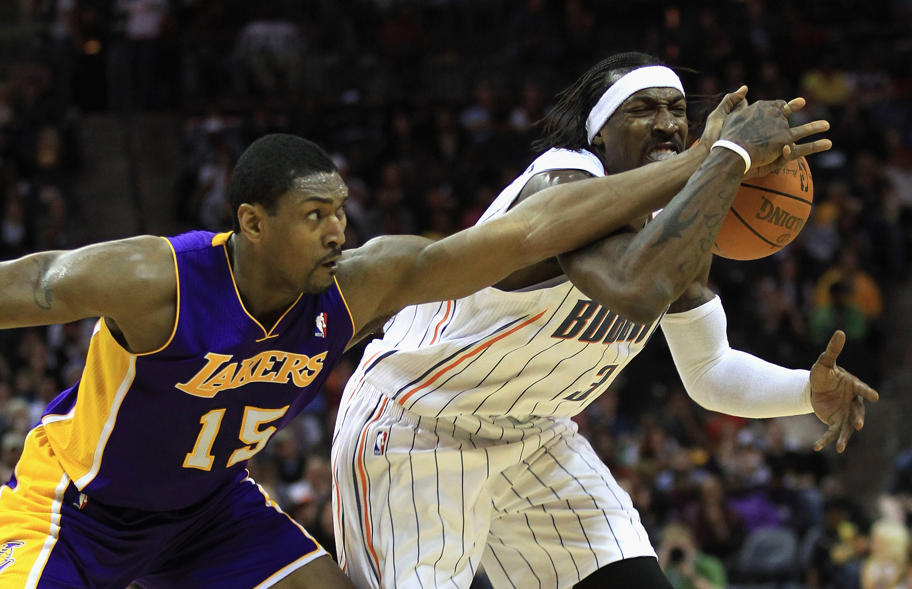 CHARLOTTE, NC - FEBRUARY 14:  Ron Artest #15 of the Los Angeles Lakers knocks the ball loose from Gerald Wallace #3 of the Charlotte Bobcats during their game at Time Warner Cable Arena on February 14, 2011 in Charlotte, North Carolina. NOTE TO USER: User