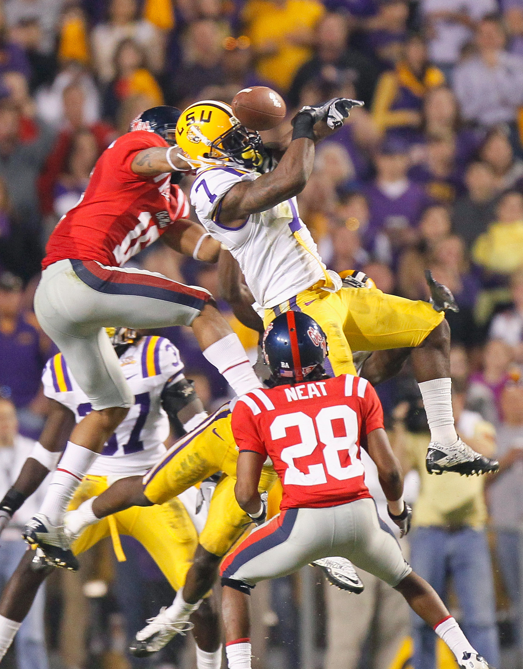 BATON ROUGE, LA - NOVEMBER 20:  Patrick Peterson #7 of the Louisiana State University Tigers nearly intercepts a pass in the final seconds against Markeith Summers #16 and Korvic Neat #28 of the Ole Miss Rebels as time expired at Tiger Stadium on November