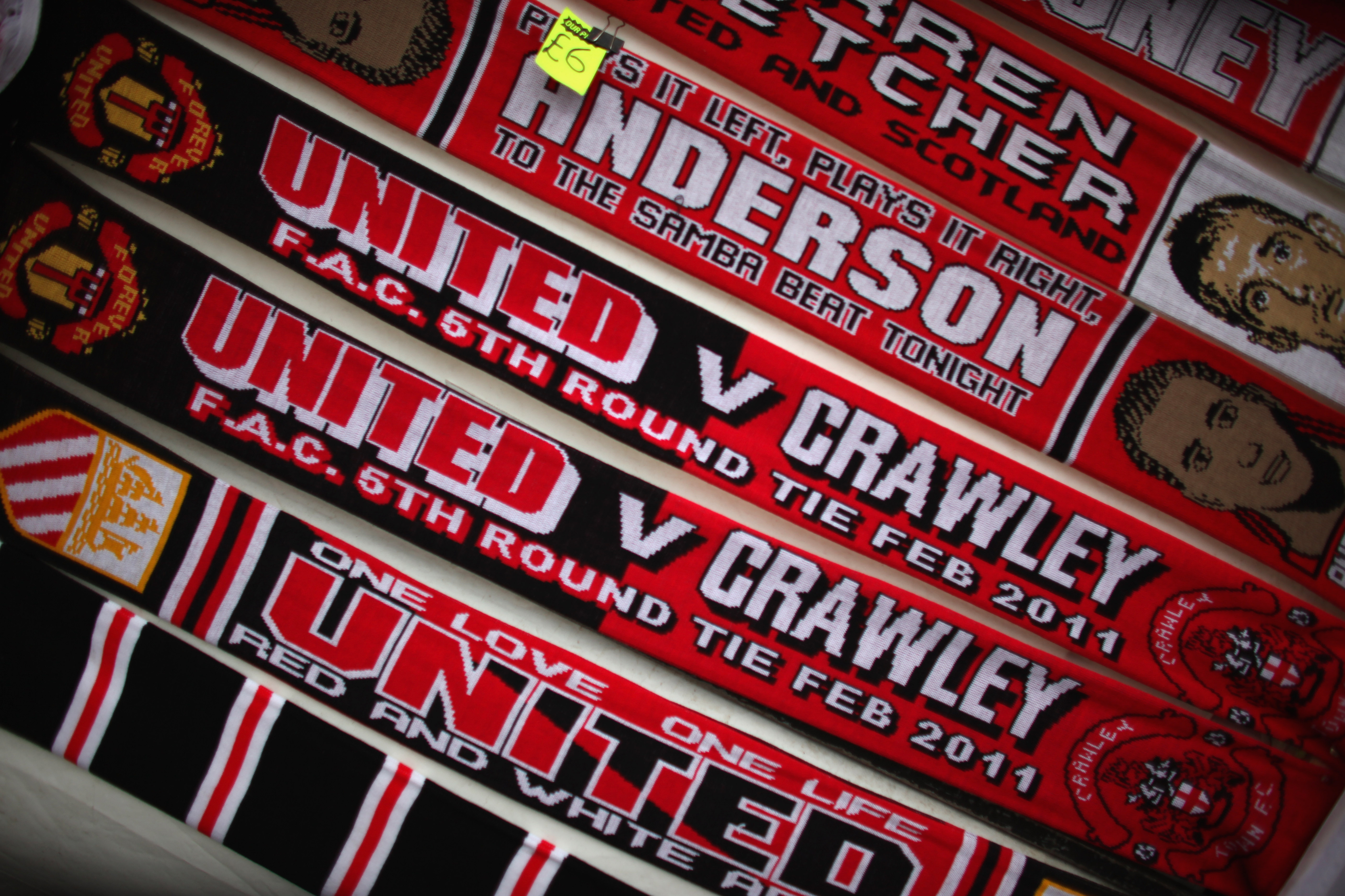 MANCHESTER, UNITED KINGDOM - FEBRUARY 19:  Commemorative scarves for sale outside Old Trafford before Crawley Town take on Manchester United in the FA Cup fifth round on February 19, 2011 in Manchester, England. The team from West Sussex are hoping to mak