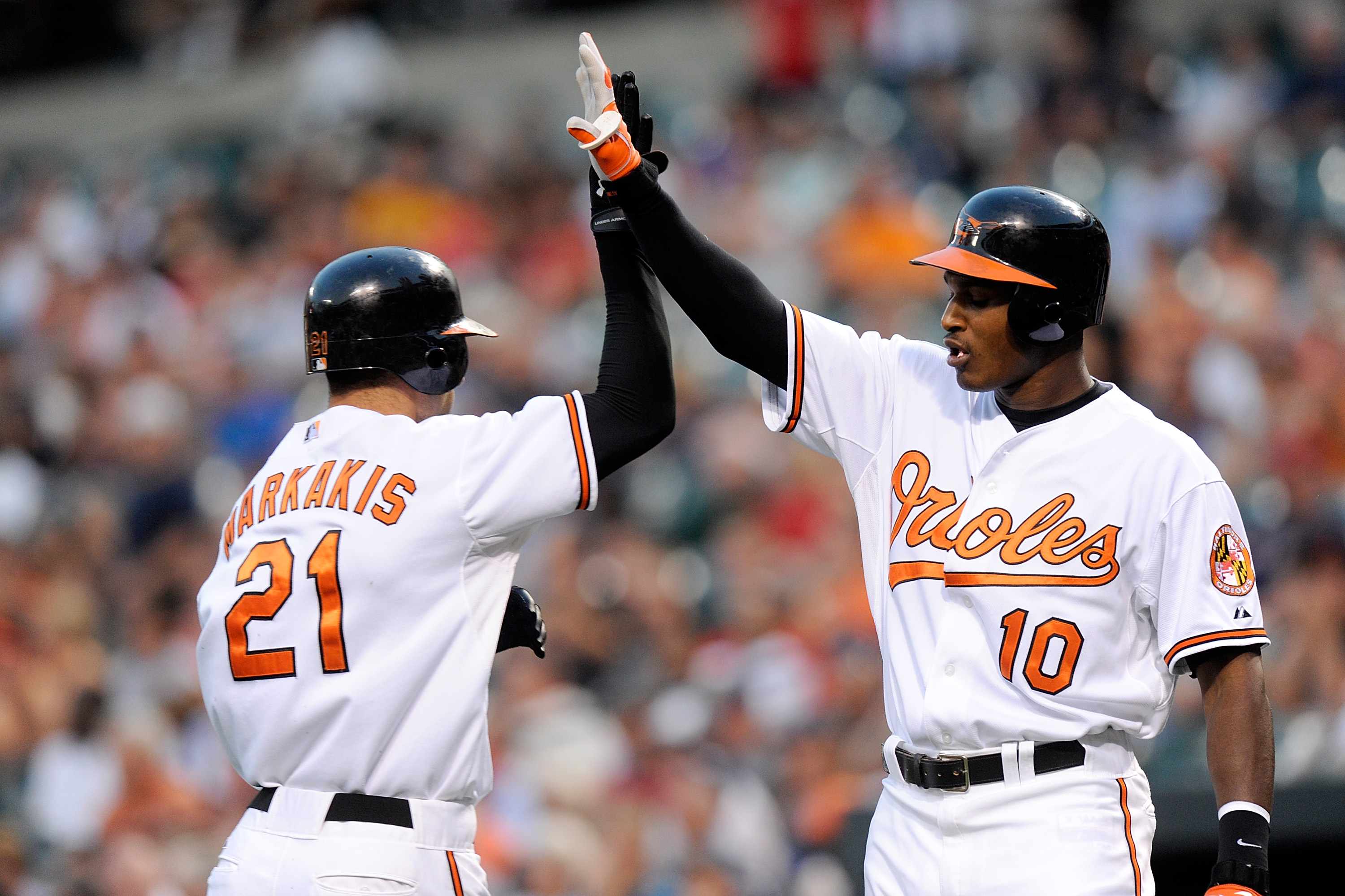 BALTIMORE - AUGUST 31:  Nick Markakis #21 of the Baltimore Orioles is congratulated by teammate Adam Jones #10 after scoring in the first inning against the Boston Red Sox at Camden Yards on August 31, 2010 in Baltimore, Maryland.  (Photo by Greg Fiume/Ge