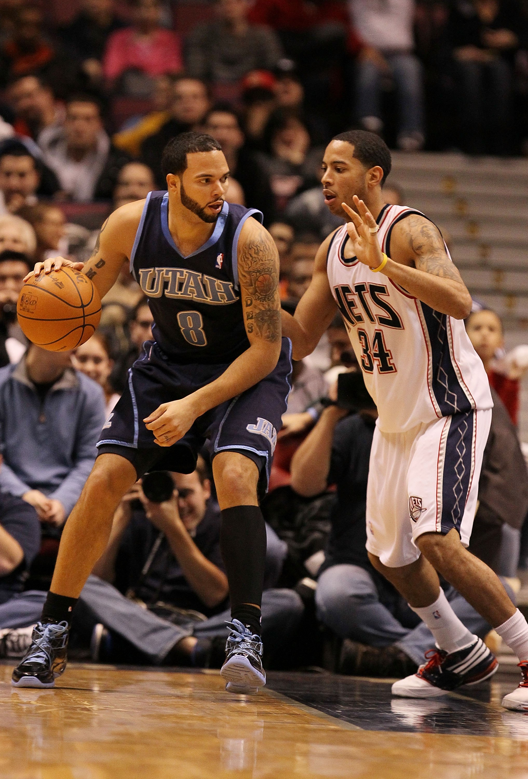 EAST RUTHERFORD, NJ - DECEMBER 16:  Devin Harris #34 of the New Jersey Nets guards Deron Williams #8 of The Utah Jazz during their game on December 16th, 2009 at The Izod Center in East Rutherford, New Jersey.  NOTE TO USER: User expressly acknowledges an