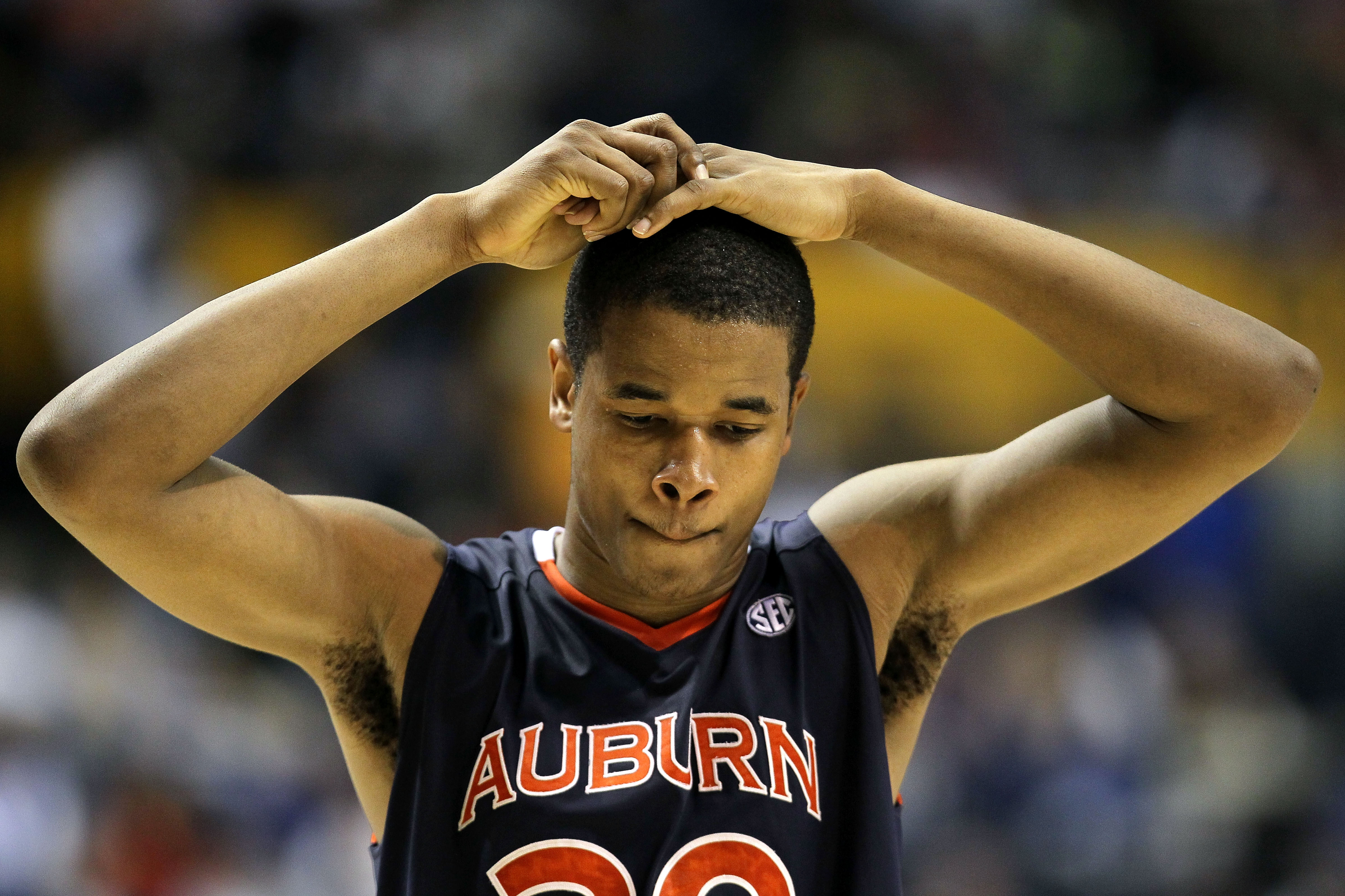 NASHVILLE, TN - MARCH 11:  Brendon Knox #30 of the Auburn Tigers looks on dejected after they lost 78-69 the Florida Gators during the first round of the SEC Men's Basketball Tournament at the Bridgestone Arena on March 11, 2010 in Nashville, Tennessee.