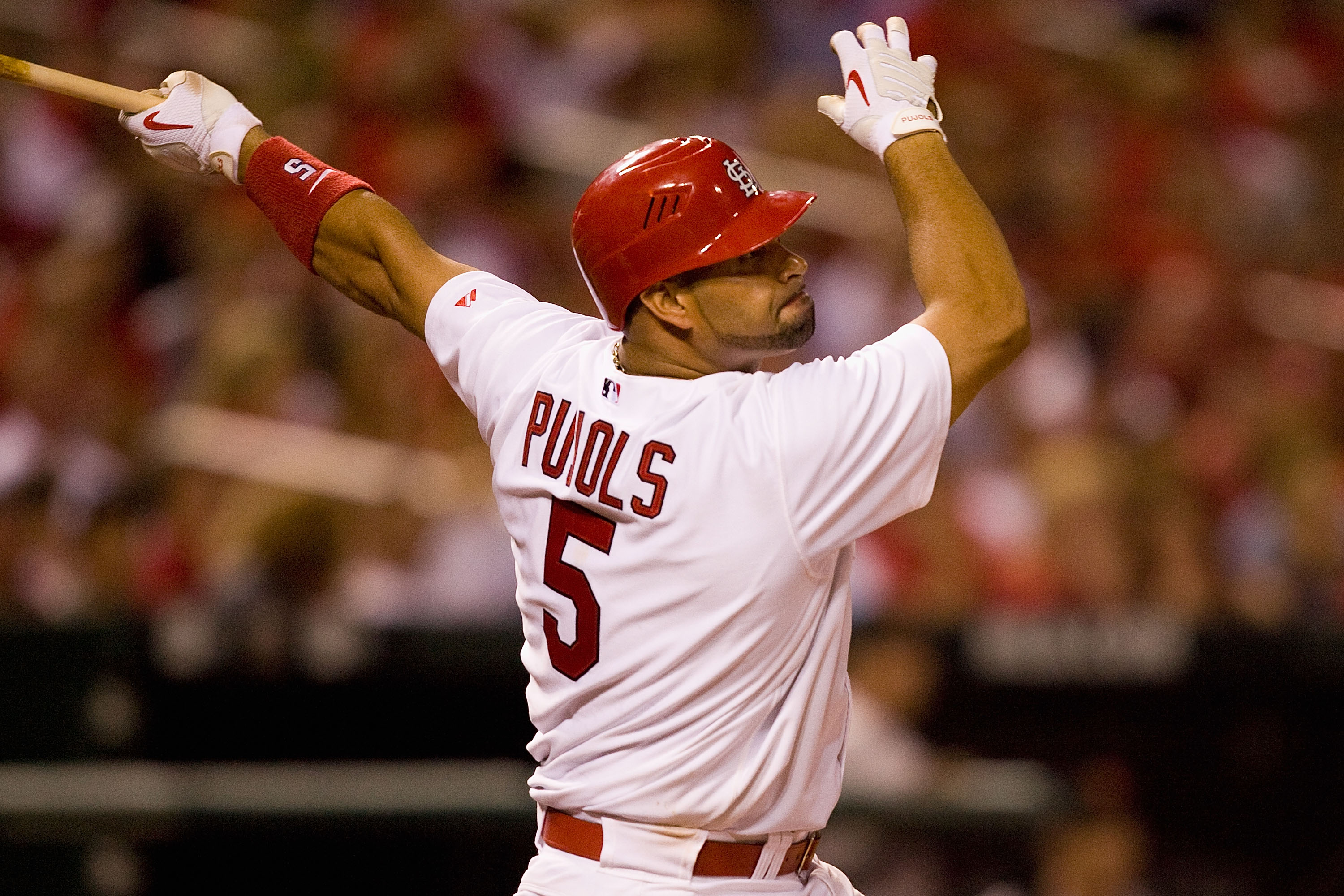 ST. LOUIS - AUGUST 21: Albert Pujols #5 of the St. Louis Cardinals bats against the San Francisco Giants at Busch Stadium on August 21, 2010 in St. Louis, Missouri.  (Photo by Dilip Vishwanat/Getty Images)