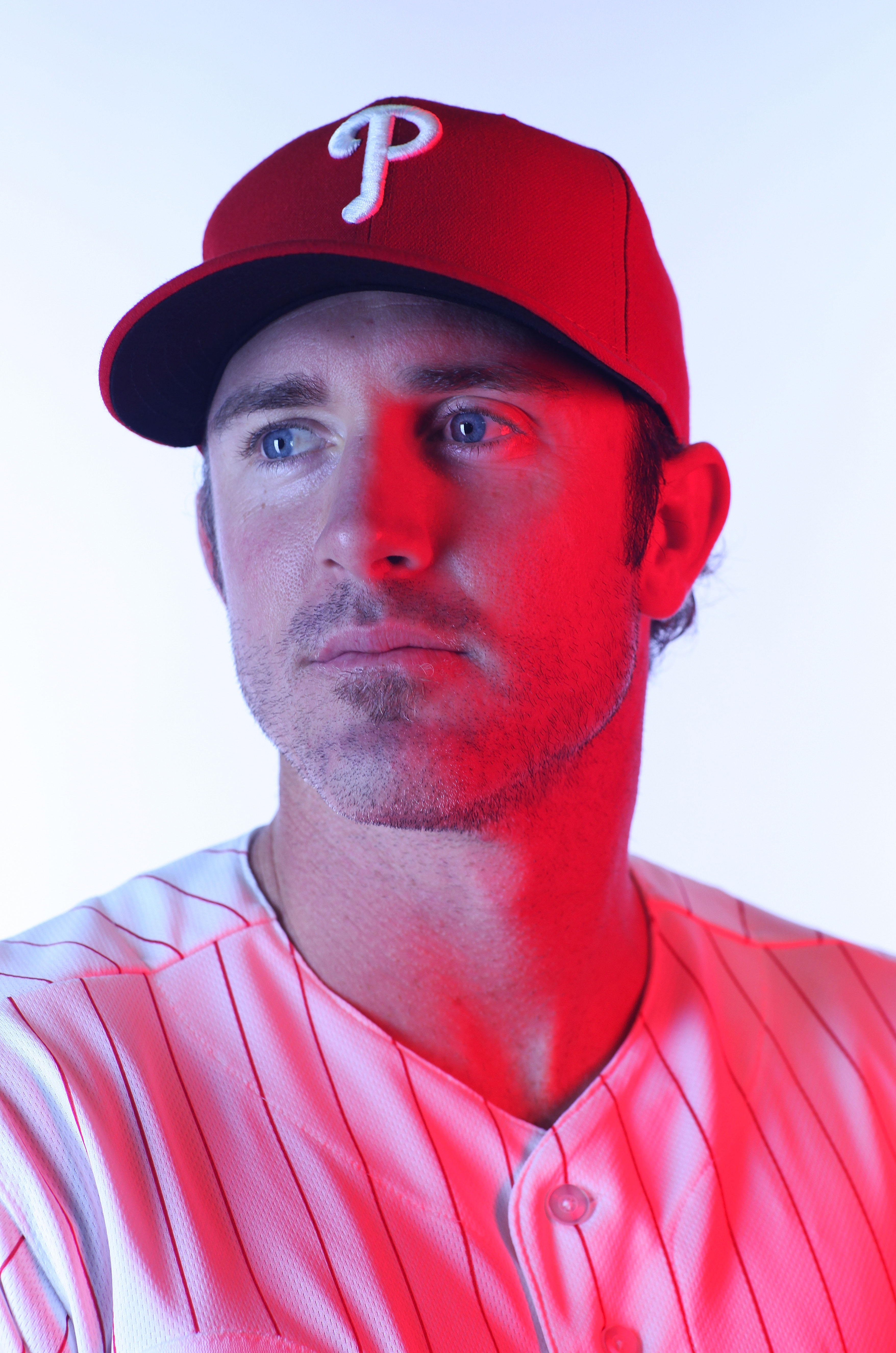 CLEARWATER, FL - FEBRUARY 22:  (EDITORS NOTE: Image was shot with a colored gel on lights) Chase Utley #26 of the Philadelphia Phillies poses for a photo during Spring Training Media Photo Day at Bright House Networks Field on February 22, 2011 in Clearwa