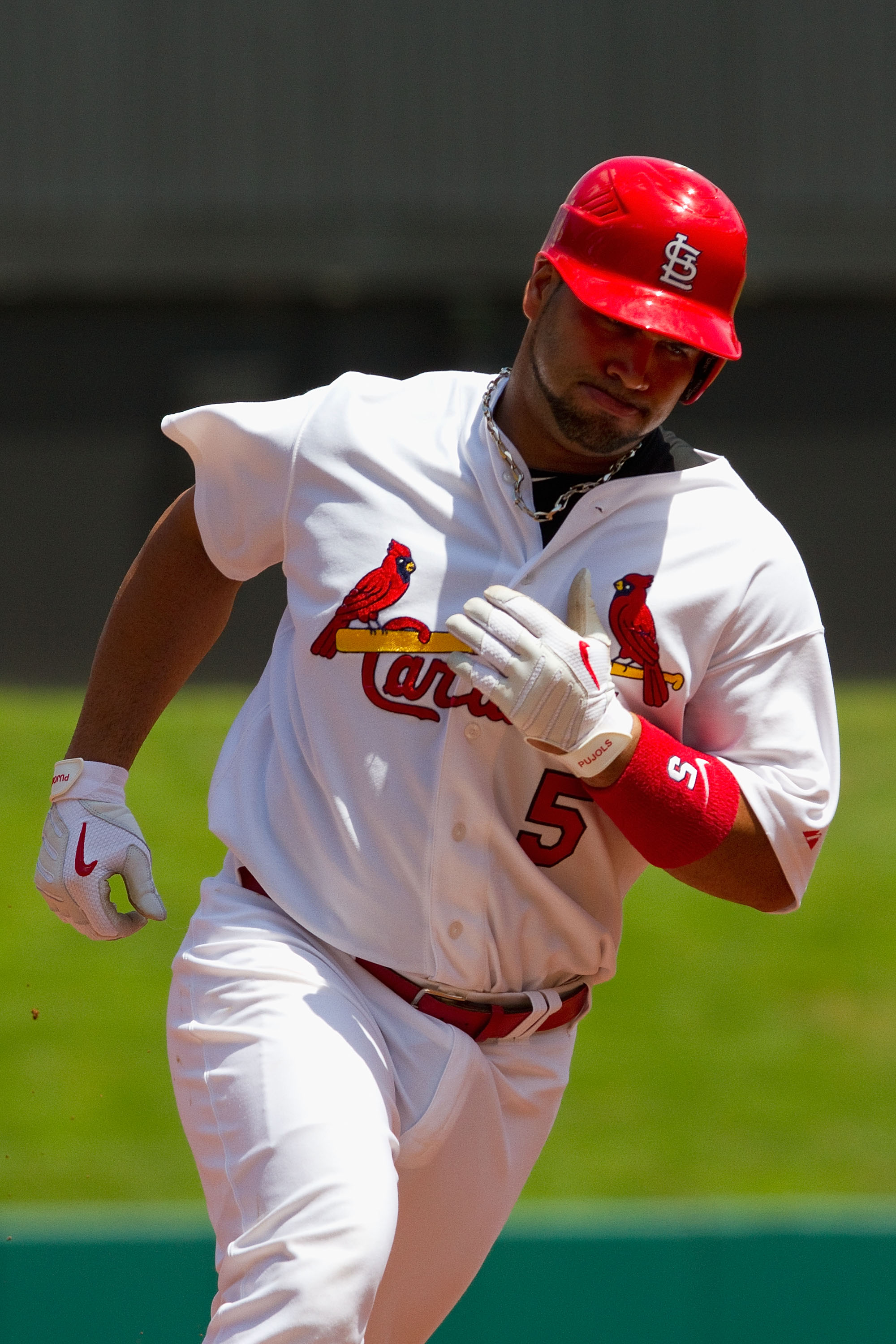 ST. LOUIS - AUGUST 15: Albert Pujols #5 of the St. Louis Cardinals rounds the bases after hitting a home run against the Chicago Cubs at Busch Stadium on August 15, 2010 in St. Louis, Missouri.  The Cubs beat the Cardinals 9-7.  (Photo by Dilip Vishwanat/
