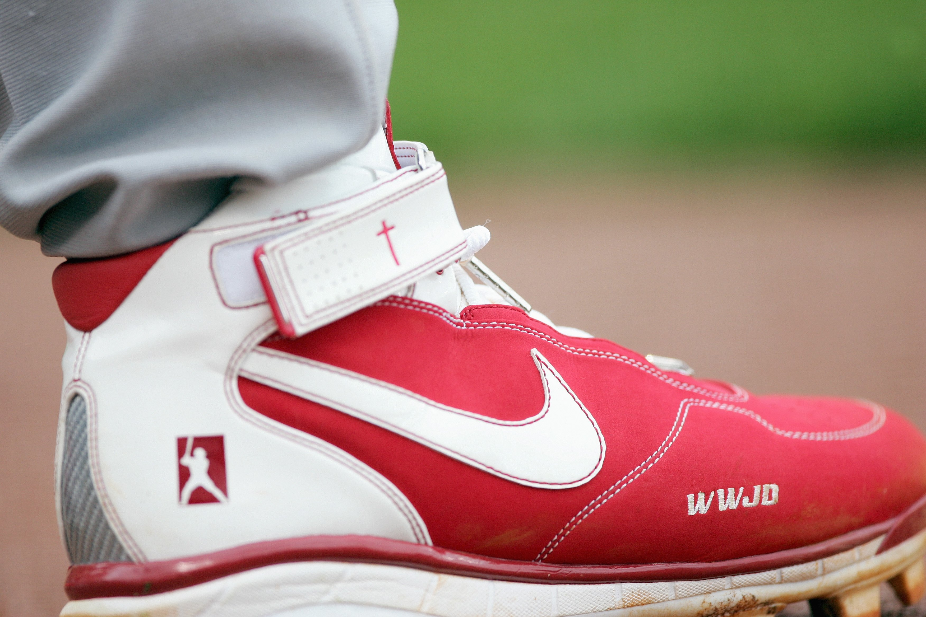 SAN FRANCISCO - APRIL 19: A view of Albert Pujols #5 of the St. Louis Cardinals shoe showing the Pujoles Family Foundation and WWJS 'What would Jesus do?'taken on the field against the San Francisco Giants during a Major League Baseball game on April 19,