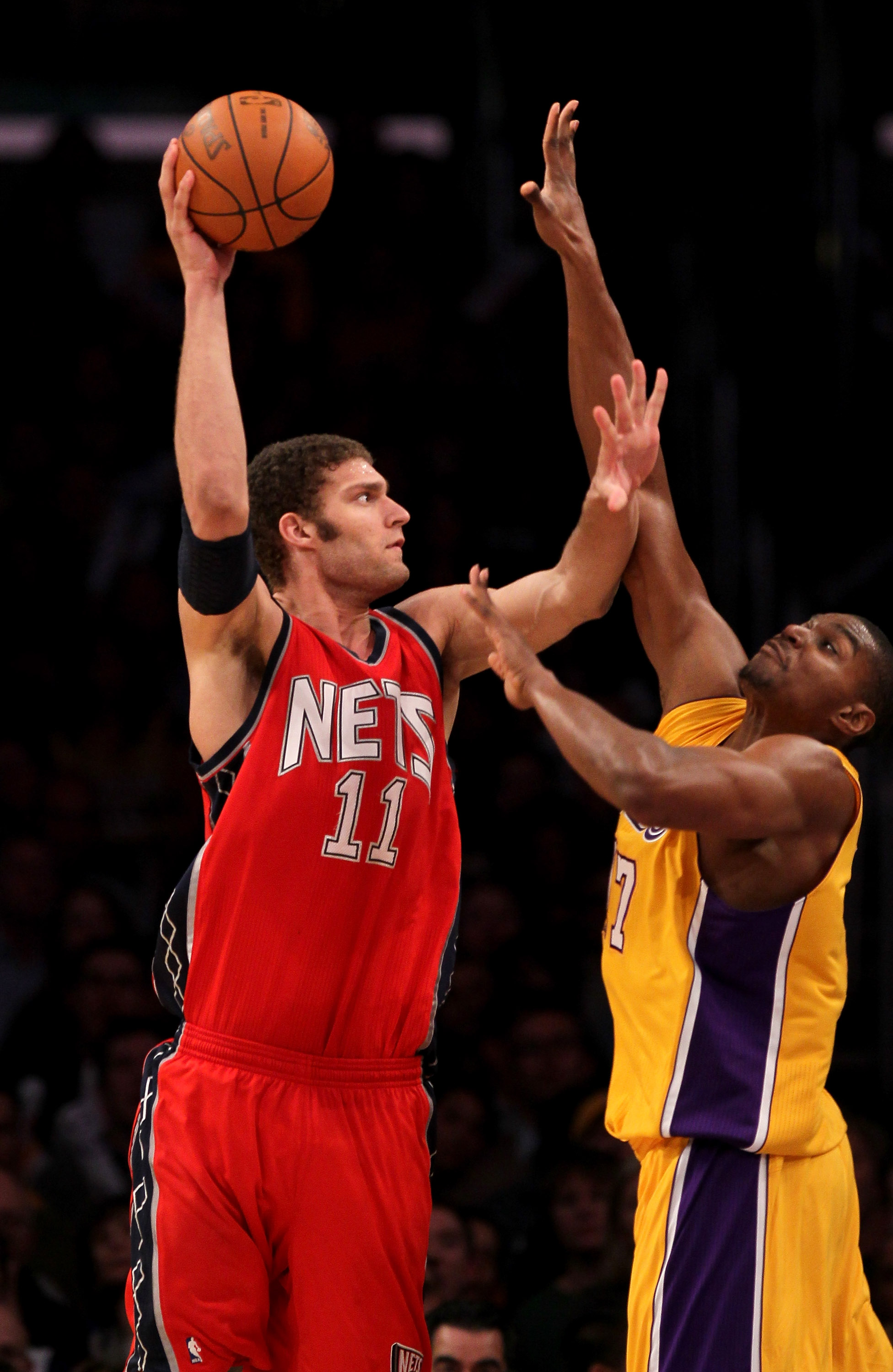 LOS ANGELES, CA - JANUARY 14: Brook Lopez #11 of the New Jersey Nets shoots over Andrew Bynum #17 of the Los Angeles Lakers at Staples Center on January 14, 2011 in Los Angeles, California. The Lakers won 100-88.  NOTE TO USER: User expressly acknowledges