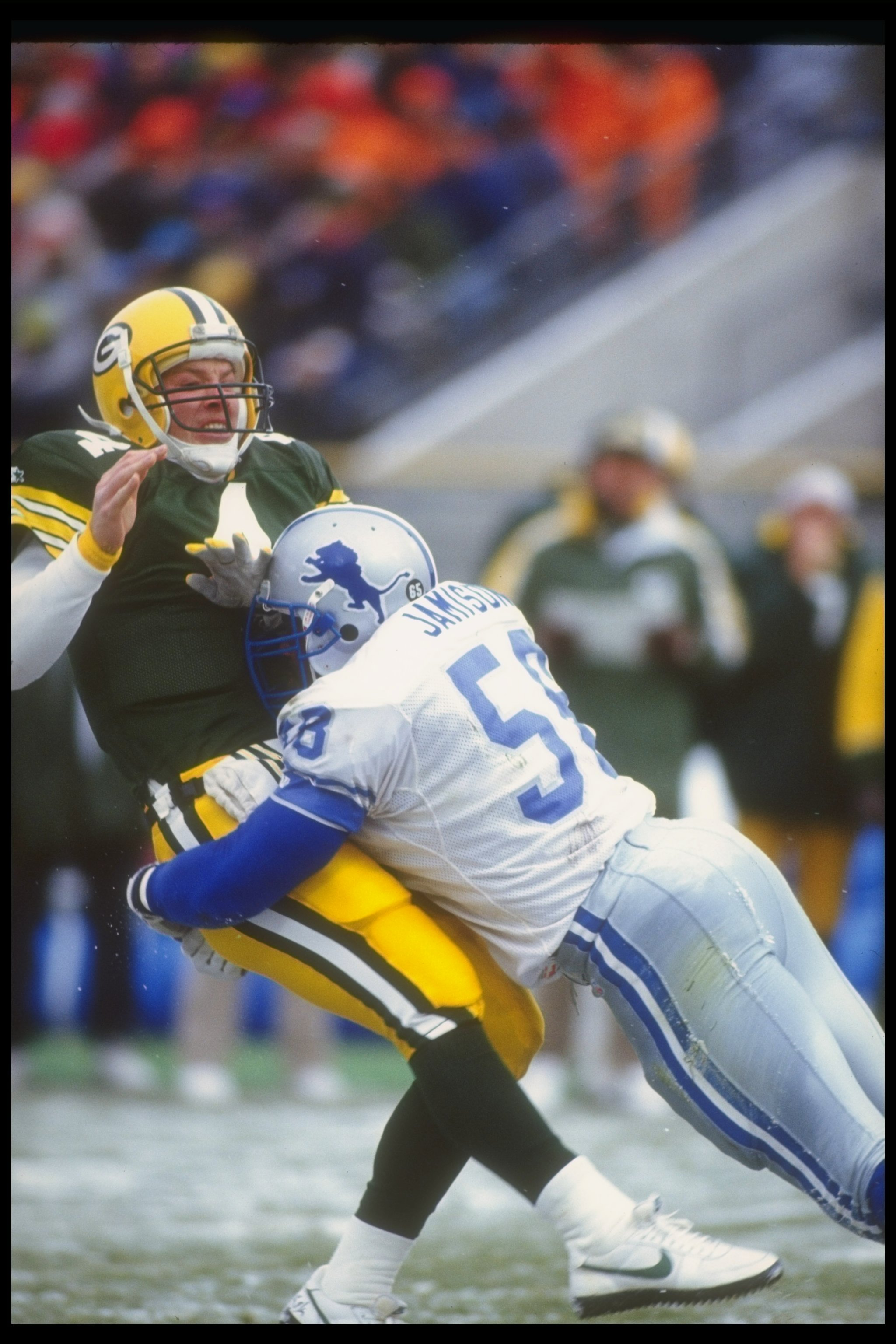 6 Dec 1992: Defensive lineman George Jamison of the Detroit Lions (right) sacks Green Bay Packers quarterback Brett Favre during a game at Milwaukee County Stadium in Milwaukee, Wisconsin. The Packers won the game, 38-10.