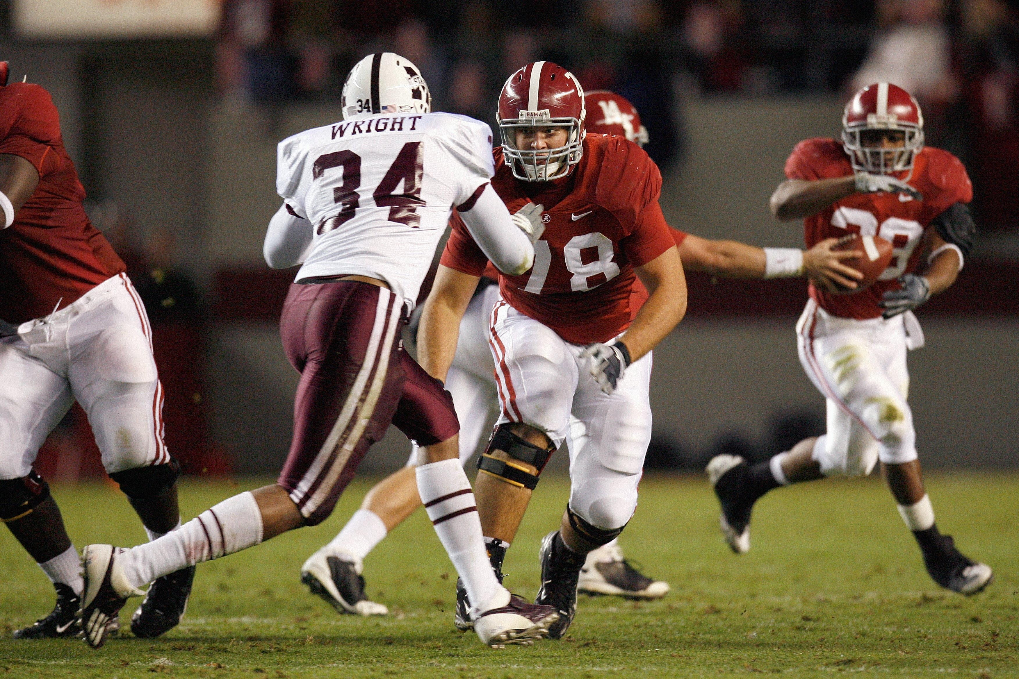 TUSCALOOSA, AL - NOVEMBER 15:  # of the Alabama Crimson Tide # of the Mississippi State Bulldogs during the game at Bryant-Denny Stadium on November 15, 2008 in Tuscaloosa, Alabama.  (Photo by Kevin C. Cox/Getty Images)