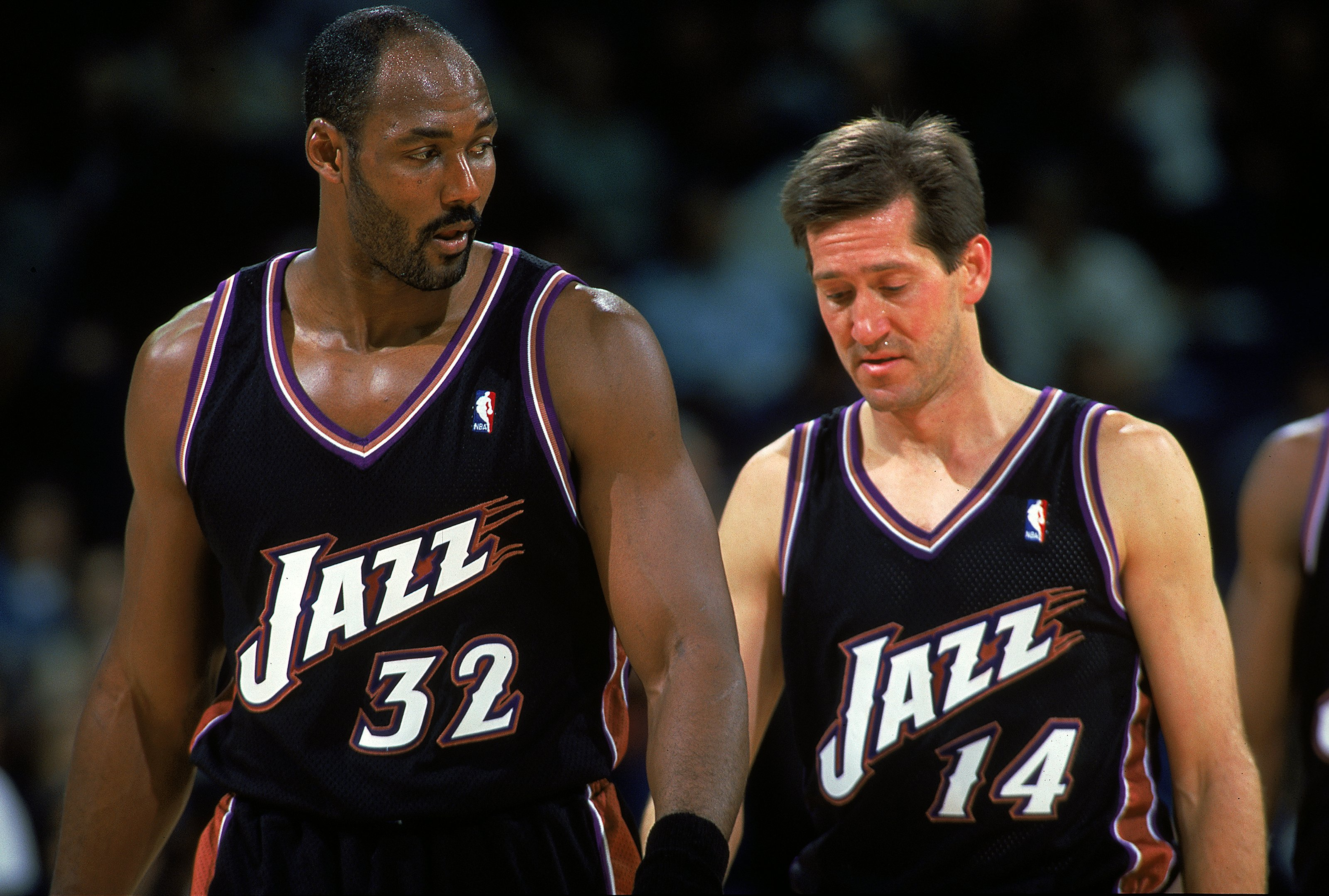 4 Dec 1999:  Karl Malone #32 and Jeff Hornacek #14 of the Utah Jazz walking back onto the court from a time out during the game against the Golden State Warriors at the Oakland Coliseum in Oakland, California. The Jazz defeated the Warriors 94-82.     Man