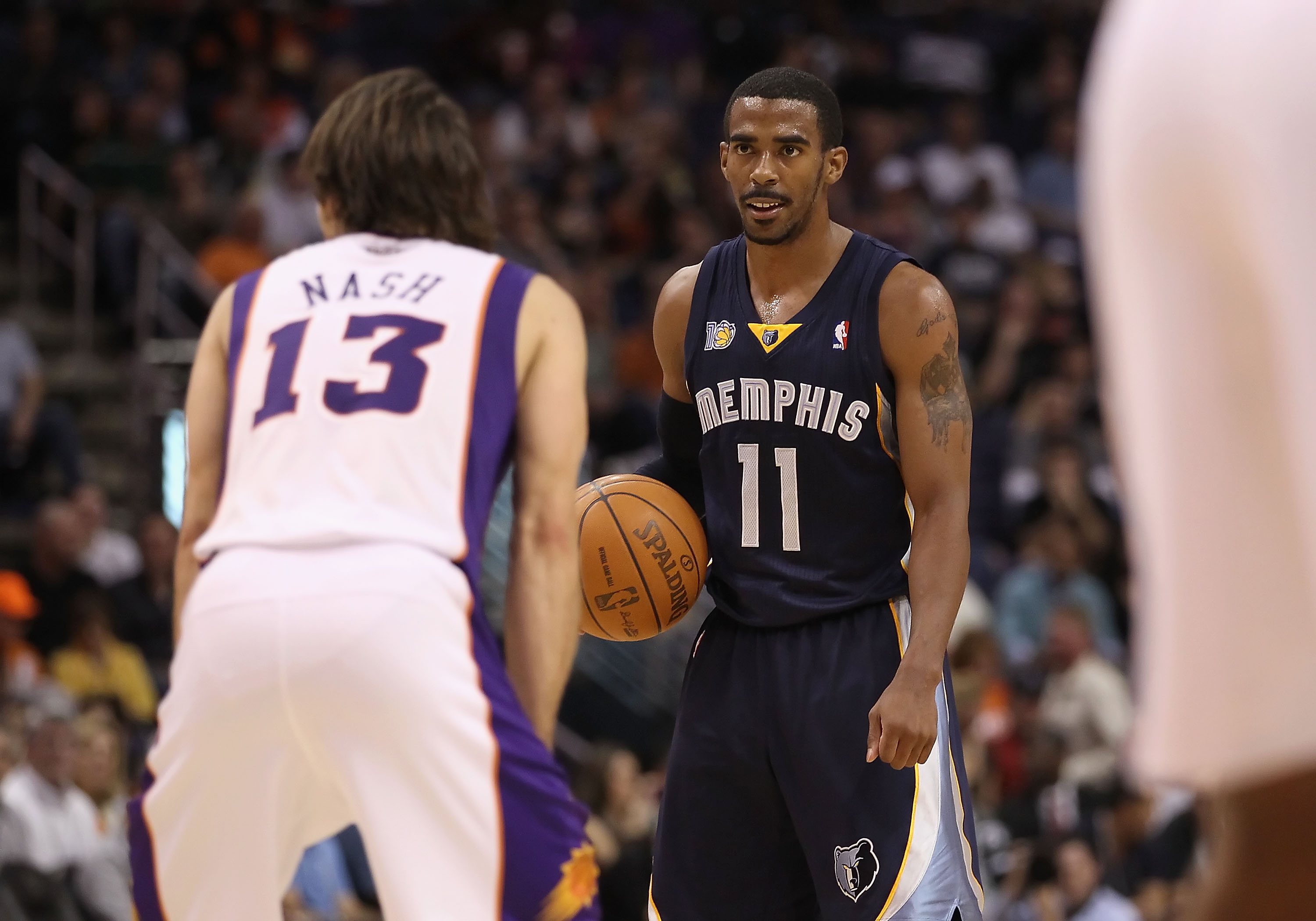 PHOENIX - DECEMBER 08:  Mike Conley #11 of the Memphis Grizzlies handles the ball against the Phoenix Suns during the NBA game at US Airways Center on December 8, 2010 in Phoenix, Arizona. NOTE TO USER: User expressly acknowledges and agrees that, by down