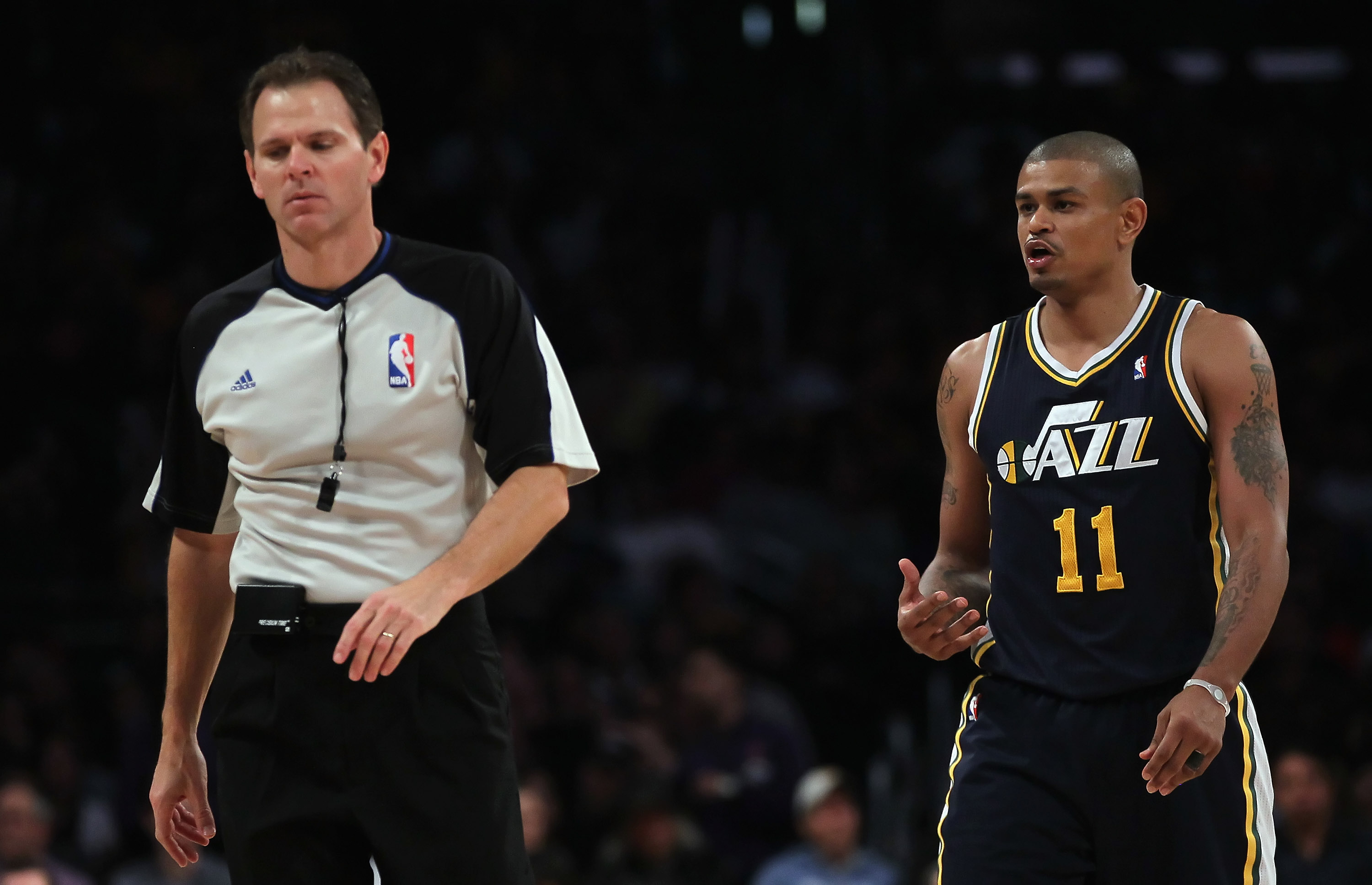 LOS ANGELES, CA - JANUARY 25:  Earl Watson #11 of the Utah Jazz argues a call with referee Mark Ayotte against the Los Angeles Lakers in the second half at Staples Center on January 25, 2011 in Los Angeles, California. The Lakers defeated the Jazz 120-91.