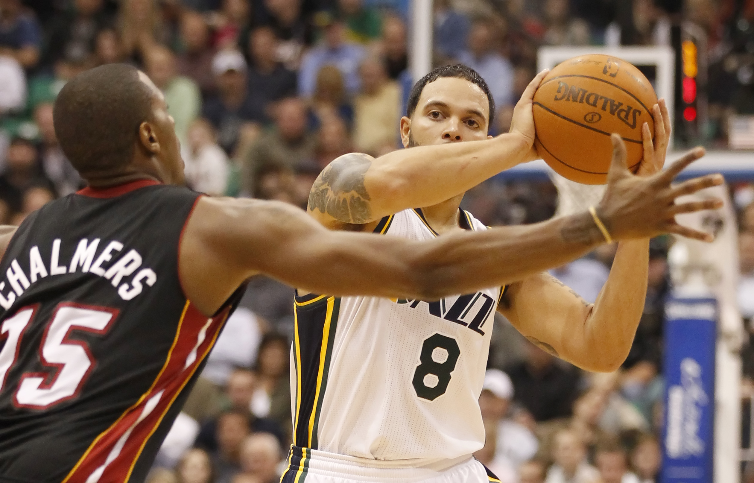 SALT LAKE CITY, UT - DECEMBER 8:  Deron Williams #8 of the Utah Jazz is pressured by Marion Chambers #15 of the Miami Heat during the second half of an NBA game December 8, 2010 at Energy Solutions Arena in Salt Lake City, Utah. The Heat beat the Jazz 111