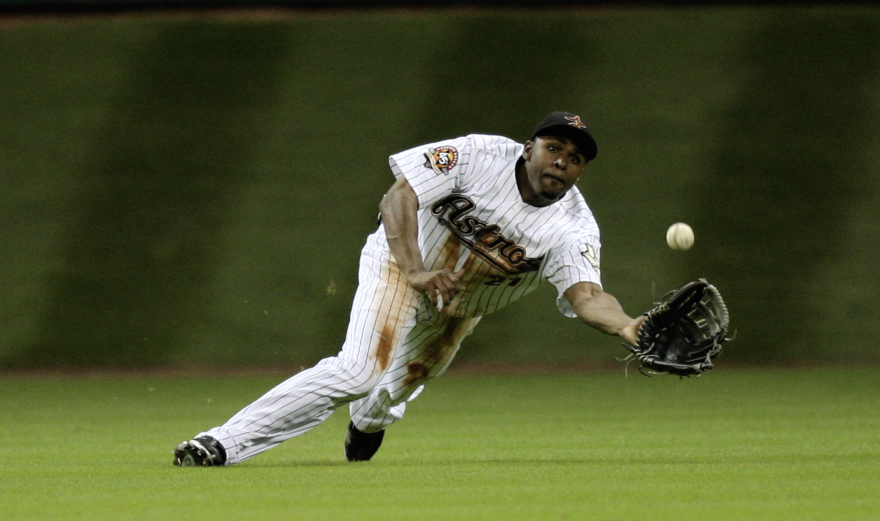 HOUSTON - JULY 30:  Center fielder Michael Bourn #21 of the Houston Astros makes a diving catch on a ball hit by Prince Fielder of the Milwaukee Brewers in the eighth inning at Minute Maid Park on July 30, 2010 in Houston, Texas.  (Photo by Bob Levey/Gett