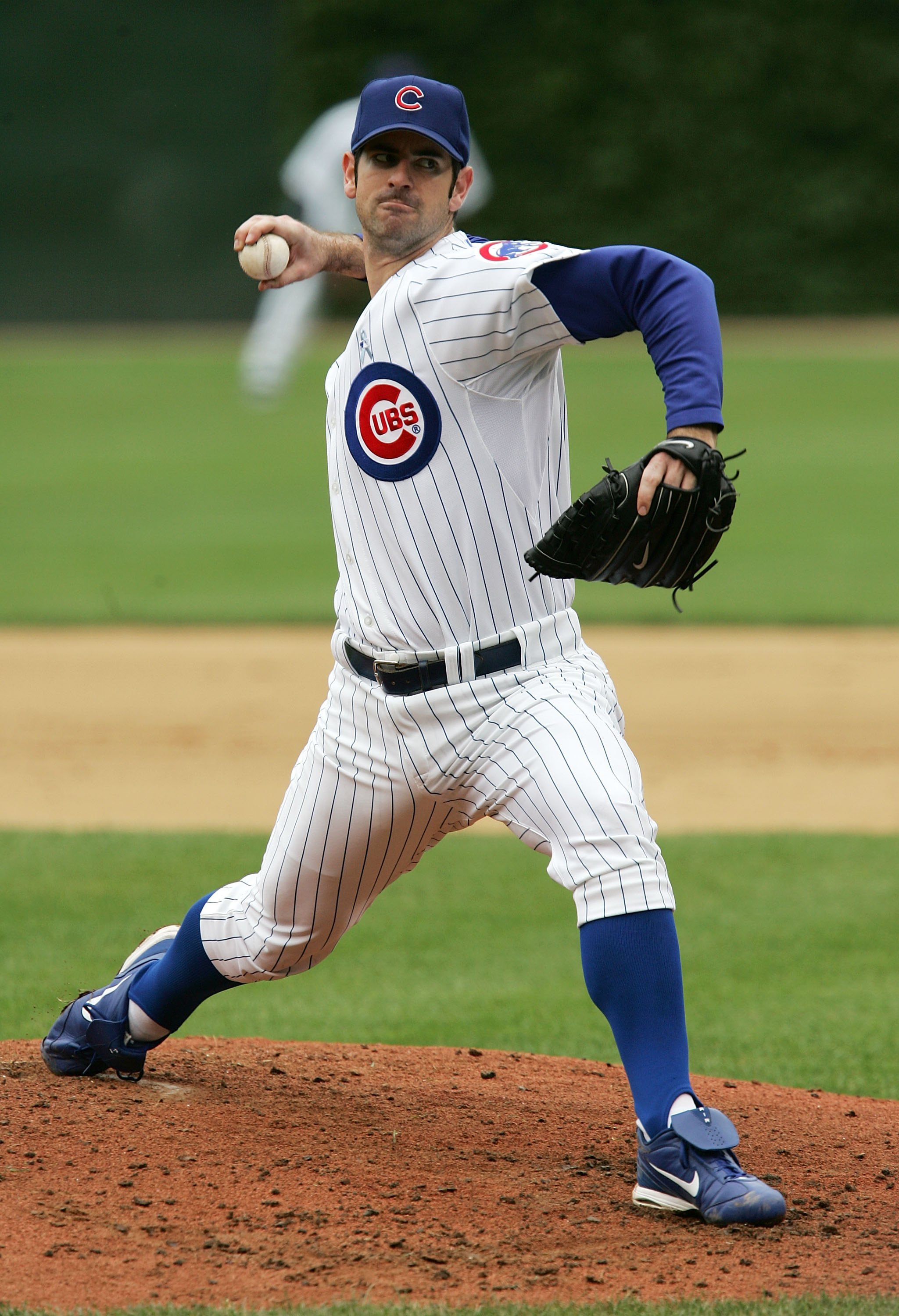 CHICAGO - JUNE 18:  Mark Prior #22 of the Chicago Cubs delivers the ball against the Detroit Tigers on June 18, 2006 at Wrigley Field in Chicago, Illinois. The Tigers defeated the Cubs 12-3.  (Photo by Jonathan Daniel/Getty Images)
