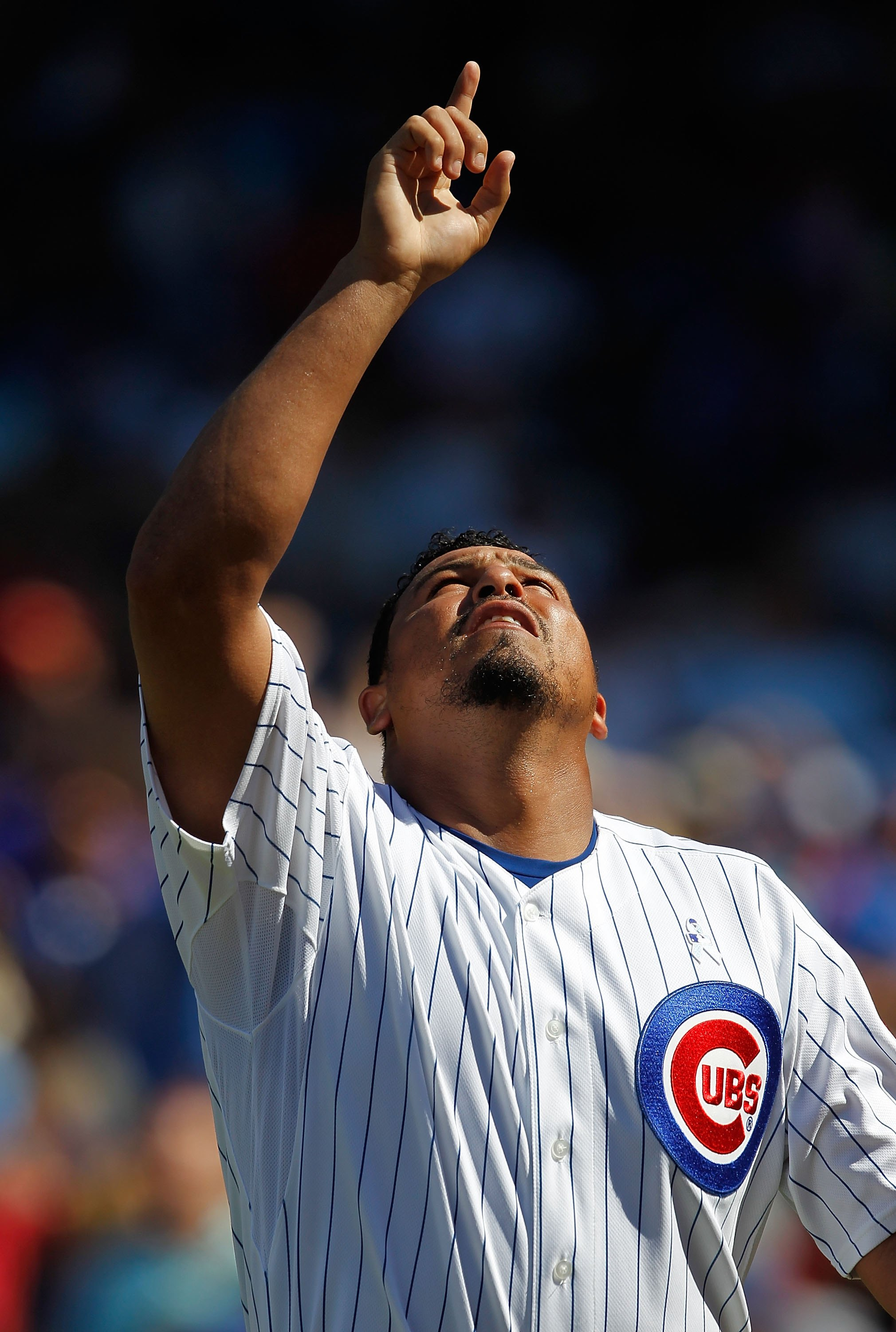 CHICAGO - JUNE 20: Starting pitcher Carlos Zambrano #38 of the Chicago Cubs points to the sky after finishing an inning pitching against the Los Angeles Angels of Anaheim at Wrigley Field on June 20, 2010 in Chicago, Illinois. The Cubs defeated the Angels