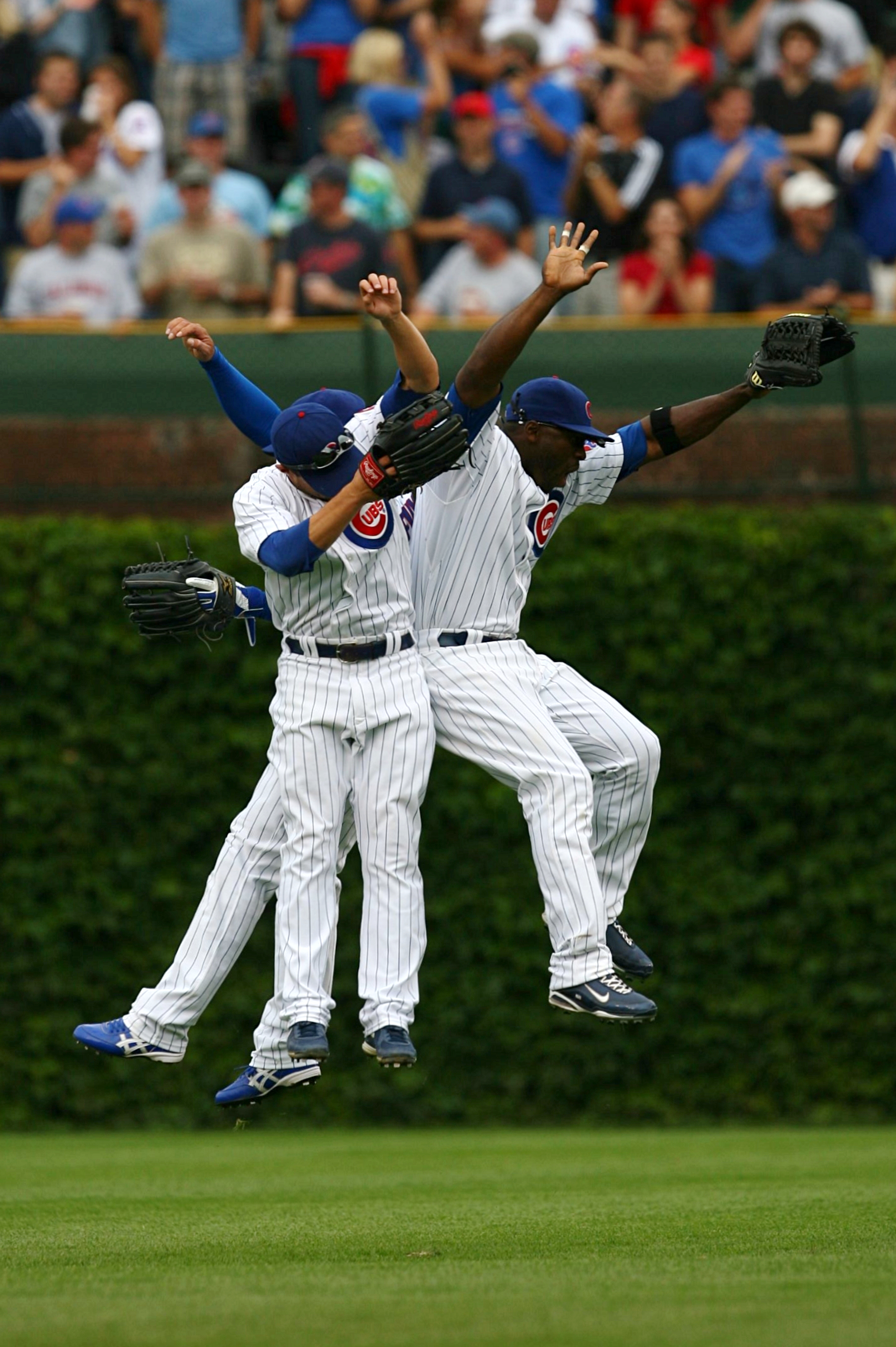CHICAGO - AUGUST 28: (R-L) Chicago Cubs outfielders Milton Bradley #21, Sam Fuld #27 and Kosuke Fukudome #1 celebrate their 5-2 win over the New York Mets at Wrigley Field on August 28, 2009 in Chicago, Illinois. (Photo by Jonathan Daniel/Getty Images)