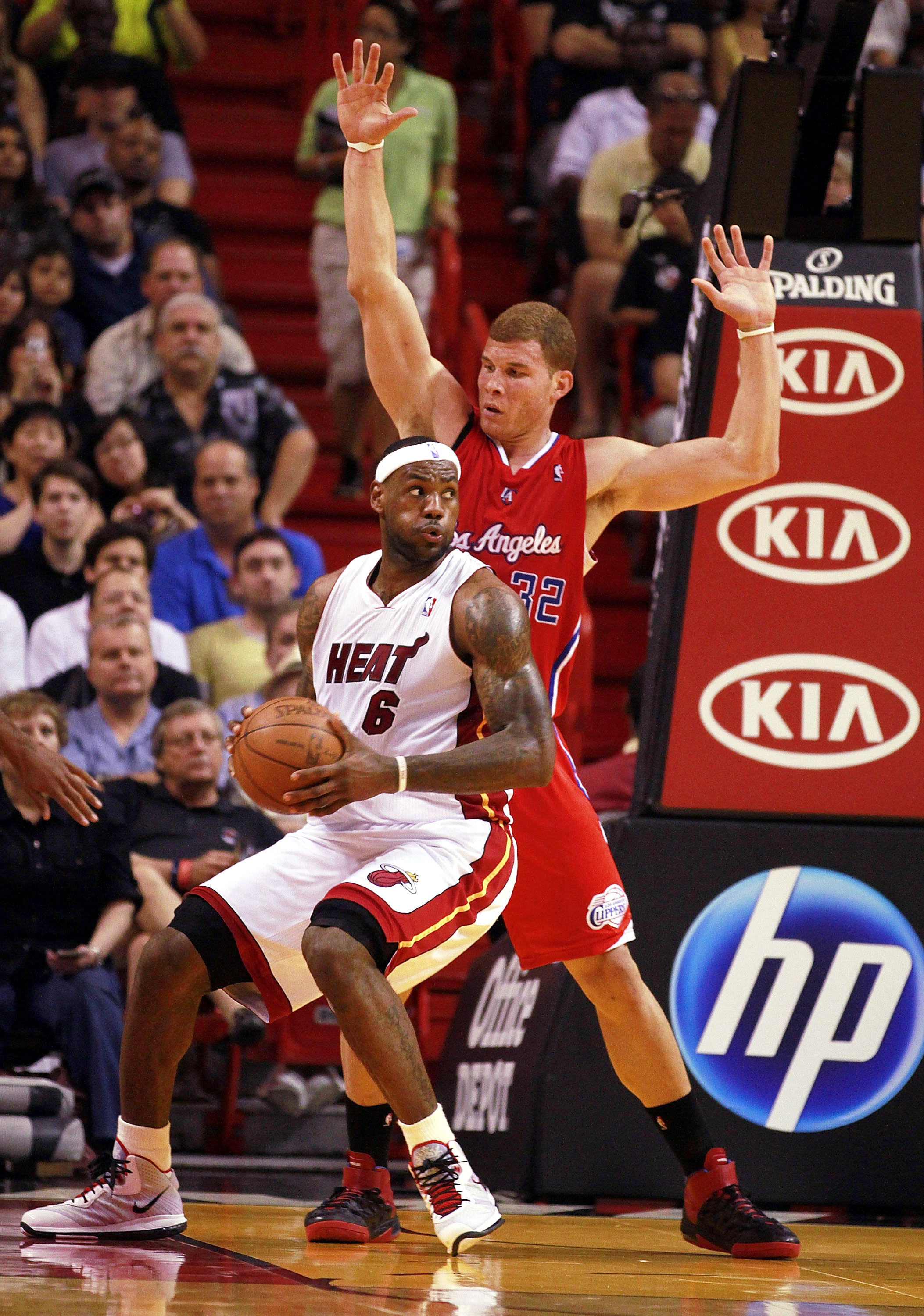 MIAMI - FEBRUARY 06:  Forward LeBron James #6 of the Miami Heat passes against guard Forward Blake Griffin #32 of the L.A. Clippers at American Airlines Arena on February 6, 2011 in Miami, Florida. NOTE TO USER: User expressly acknowledges and agrees that