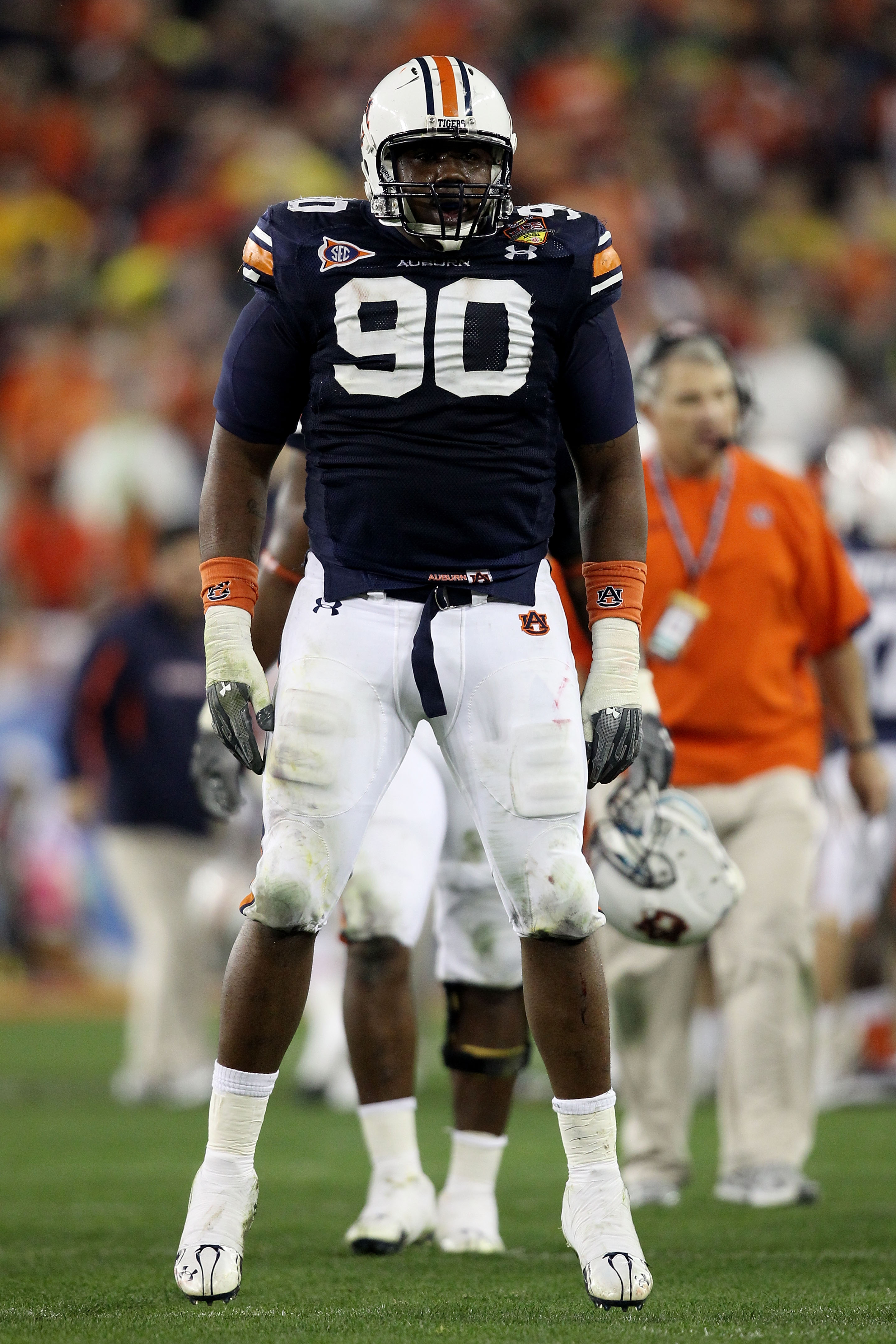 GLENDALE, AZ - JANUARY 10:  Nick Fairley #90 of the Auburn Tigers celebrates a sack against the Oregon Ducks during the Tostitos BCS National Championship Game at University of Phoenix Stadium on January 10, 2011 in Glendale, Arizona.  (Photo by Christian