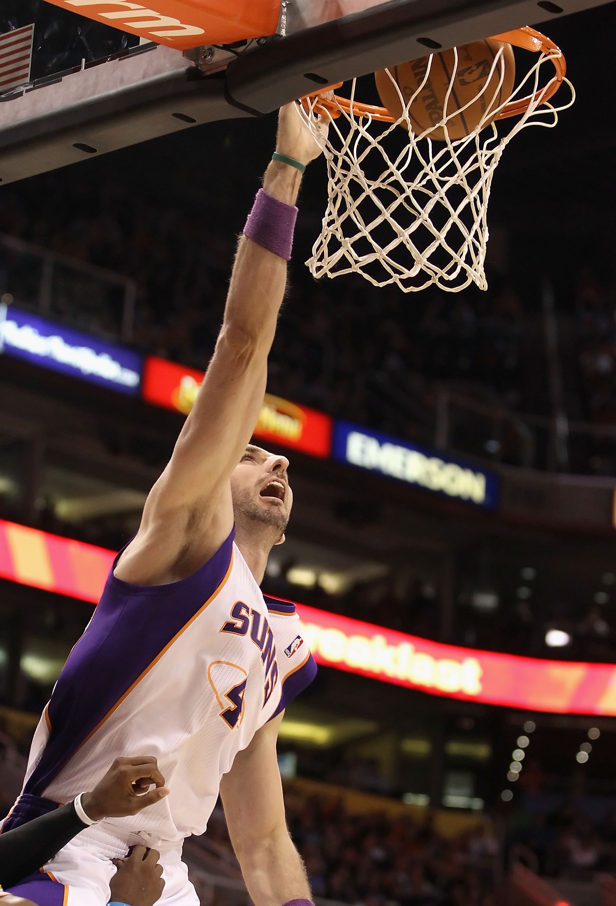 PHOENIX, AZ - JANUARY 30:  Marcin Gortat #4 of the Phoenix Suns slam dunks the ball against the New Orleans Hornets during the NBA game at US Airways Center on January 30, 2011 in Phoenix, Arizona.  The Suns defeated the Hornets 104-102. NOTE TO USER: Use