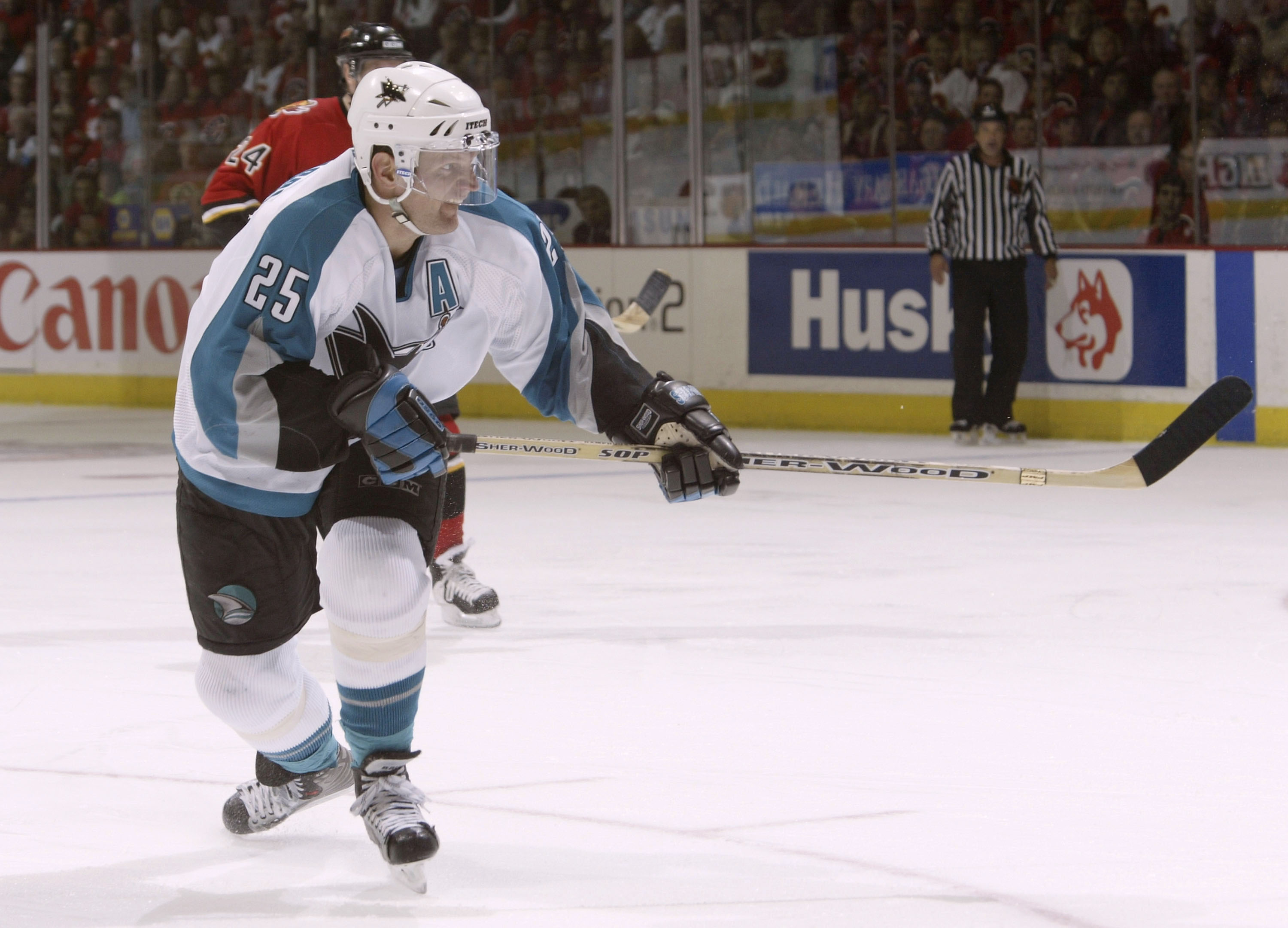 CALGARY, ALBERTA, CANADA - MAY 13:  Vincent Damphousse #25 of the San Jose Sharks scores a goal on a backhand shot against the Calgary Flames during Game three of the 2004 NHL Western Conference Finals on May 13, 2004 at the Pengrowth Saddledome in Calgar