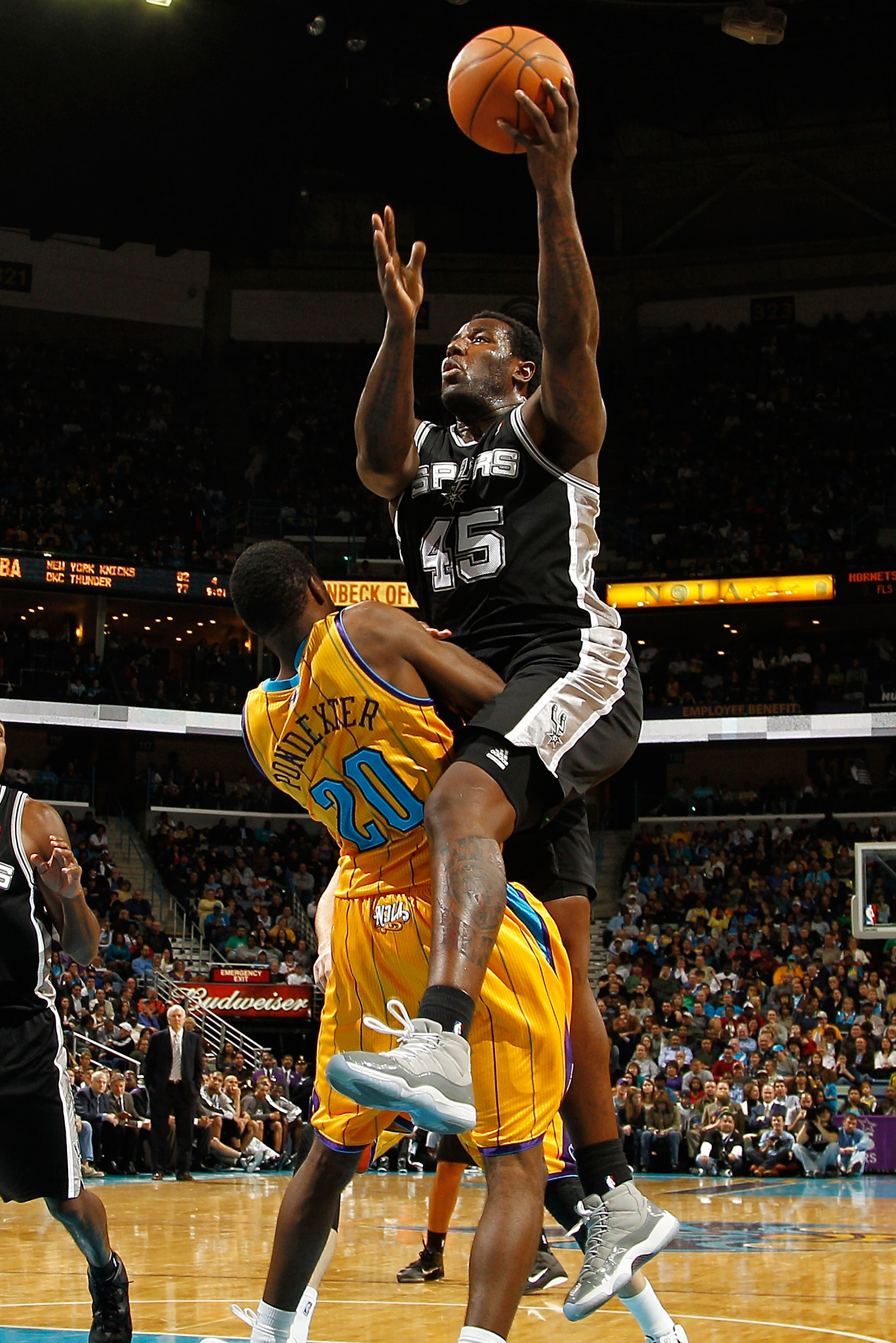 NEW ORLEANS, LA - JANUARY 22:  DeJuan Blair #45 of the San Antonio Spurs shoots the ball over Quincy Pondexter #20 of the New Orleans Hornets at the New Orleans Arena on January 22, 2011 in New Orleans, Louisiana.  The Hornets defeated the Spurs 96-72.  N