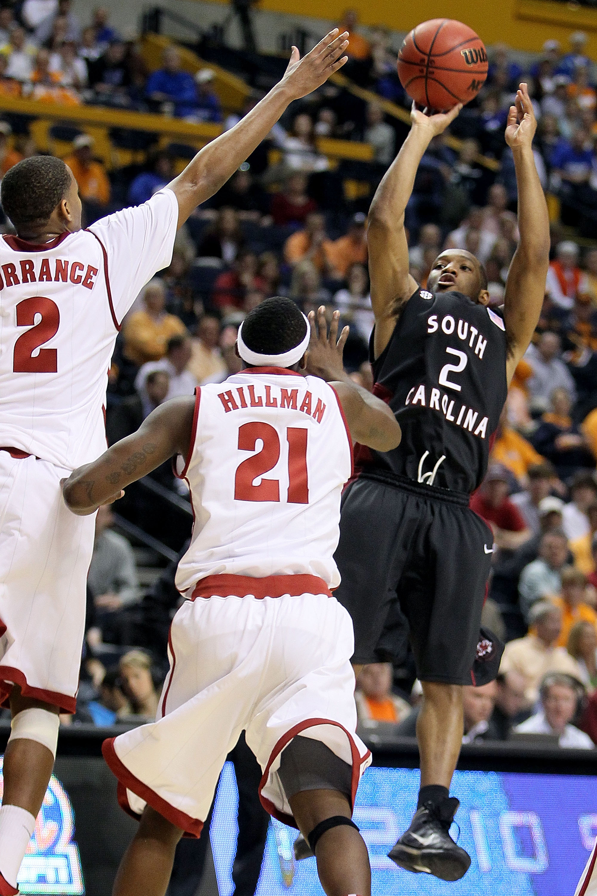 NASHVILLE, TN - MARCH 11:  Devan Downey #2 of the South Carolina attempts a shot in the second half against Mikhail Torrance #2 and Senario Hillman #21 of the Alabama Crimson Tide Gamecocks during the first round of the SEC Men's Basketball Tournament at