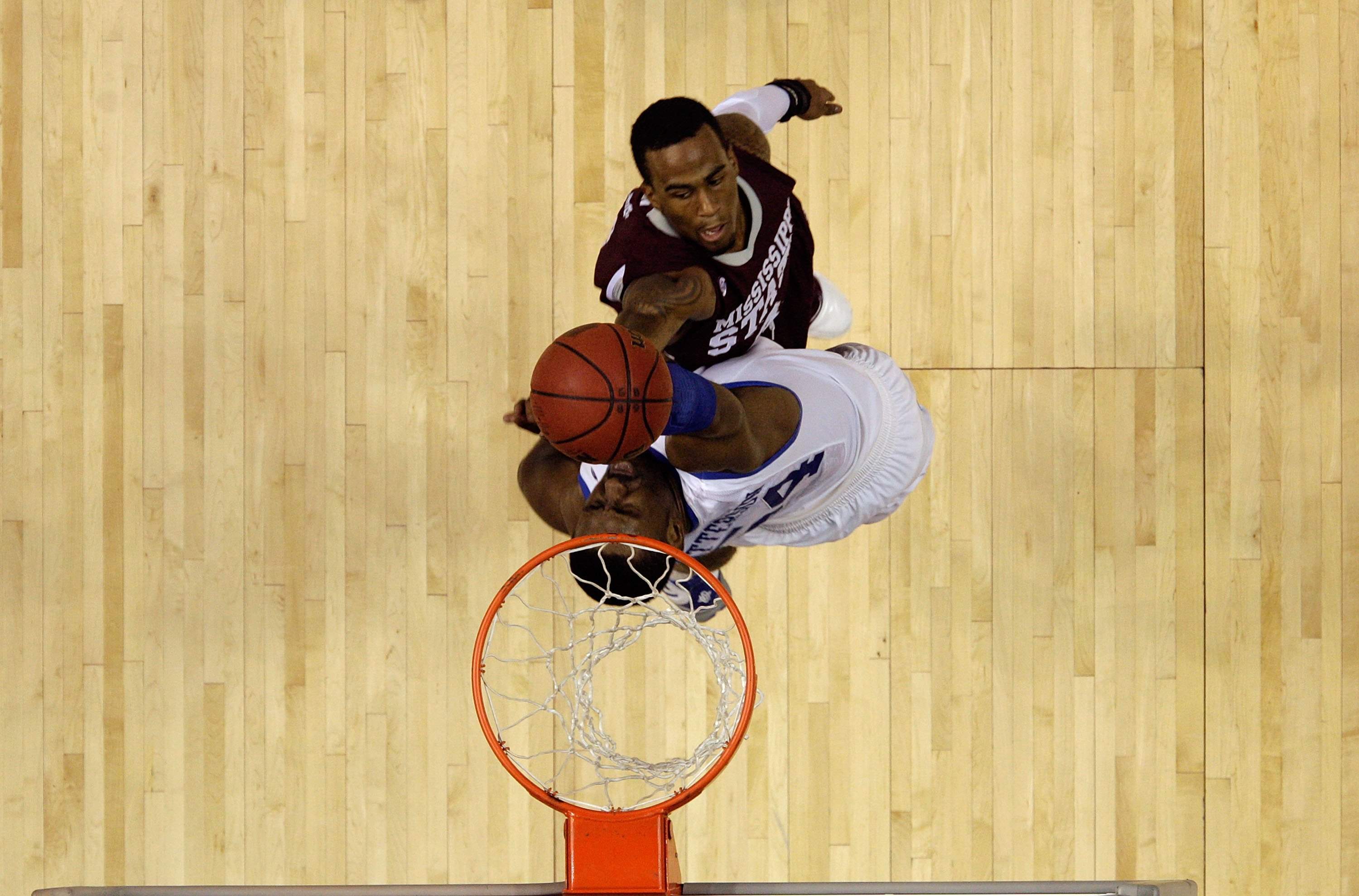 NASHVILLE, TN - MARCH 14:  Dee Bost #3 of the Mississippi State Bulldogs drives for a shot attempt against Patrick Patterson #54 of the Kentucky Wildcats during the final of the SEC Men's Basketball Tournament at the Bridgestone Arena on March 14, 2010 in