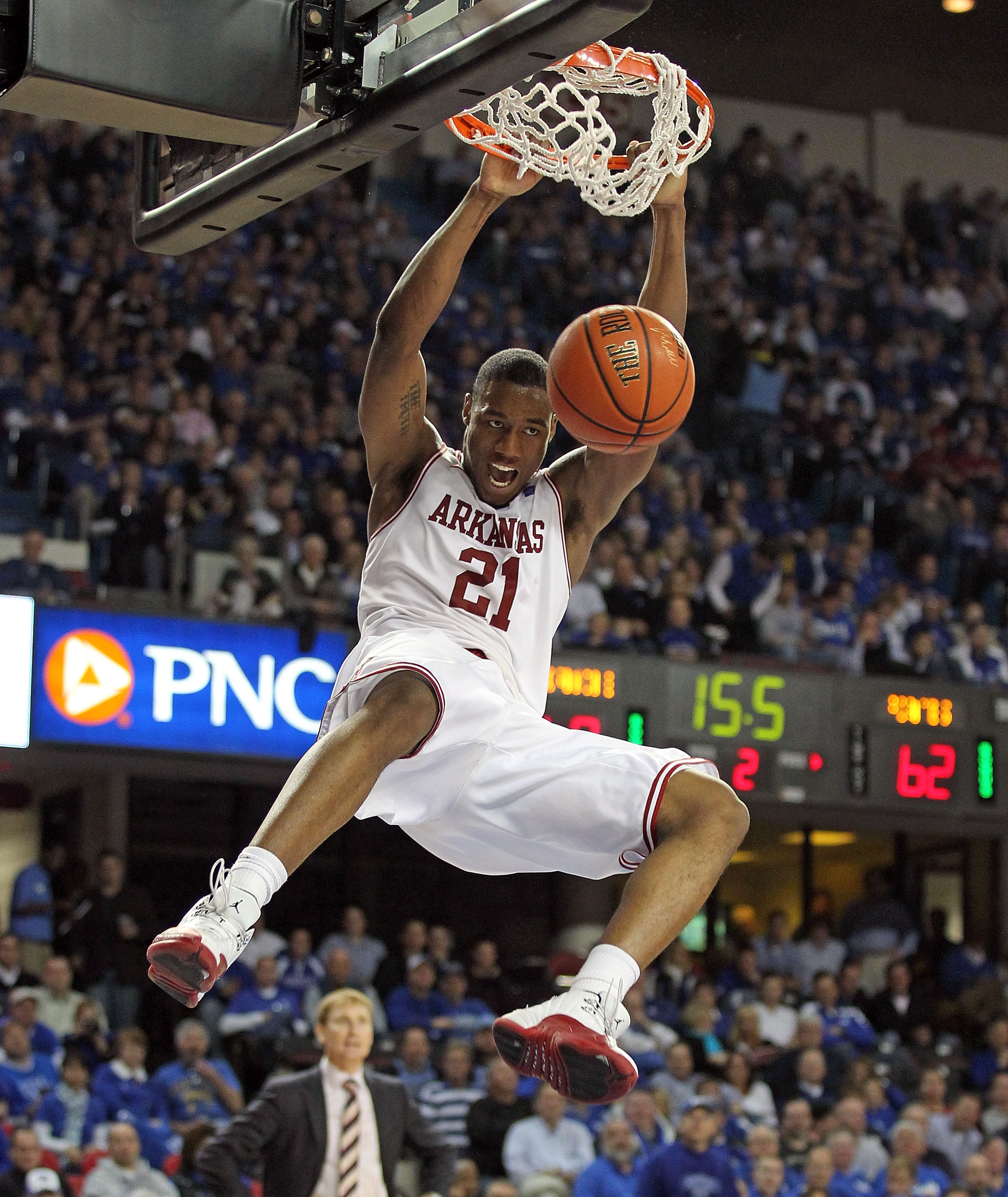 LOUISVILLE, KY - DECEMBER 08:  Delvon Johnson #21 of the Arkansas Razorbacks dunks the ball during the game against the Seton Hall Pirates in the 2010 DIRECTV SEC/BIG EAST Invitational at Freedom Hall on December 8, 2010 in Louisville, Kentucky.  (Photo b