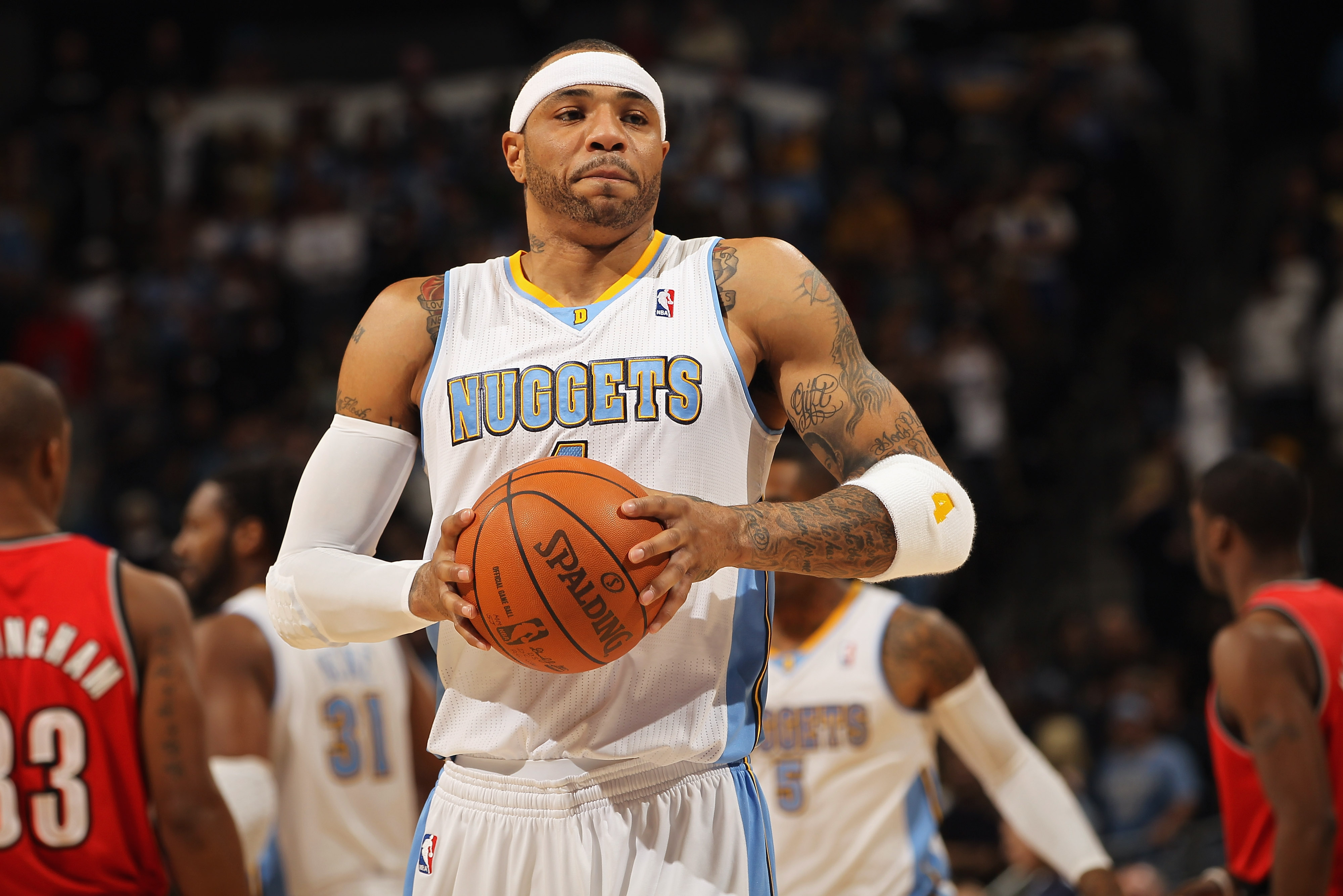 DENVER - DECEMBER 28:  Kenyon Martin #4 of the Denver Nuggets collects the ball against the Portland Trail Blazers at Pepsi Center on December 28, 2010 in Denver, Colorado. The Nuggets defeated the Blazers 95-77. NOTE TO USER: User expressly acknowledges