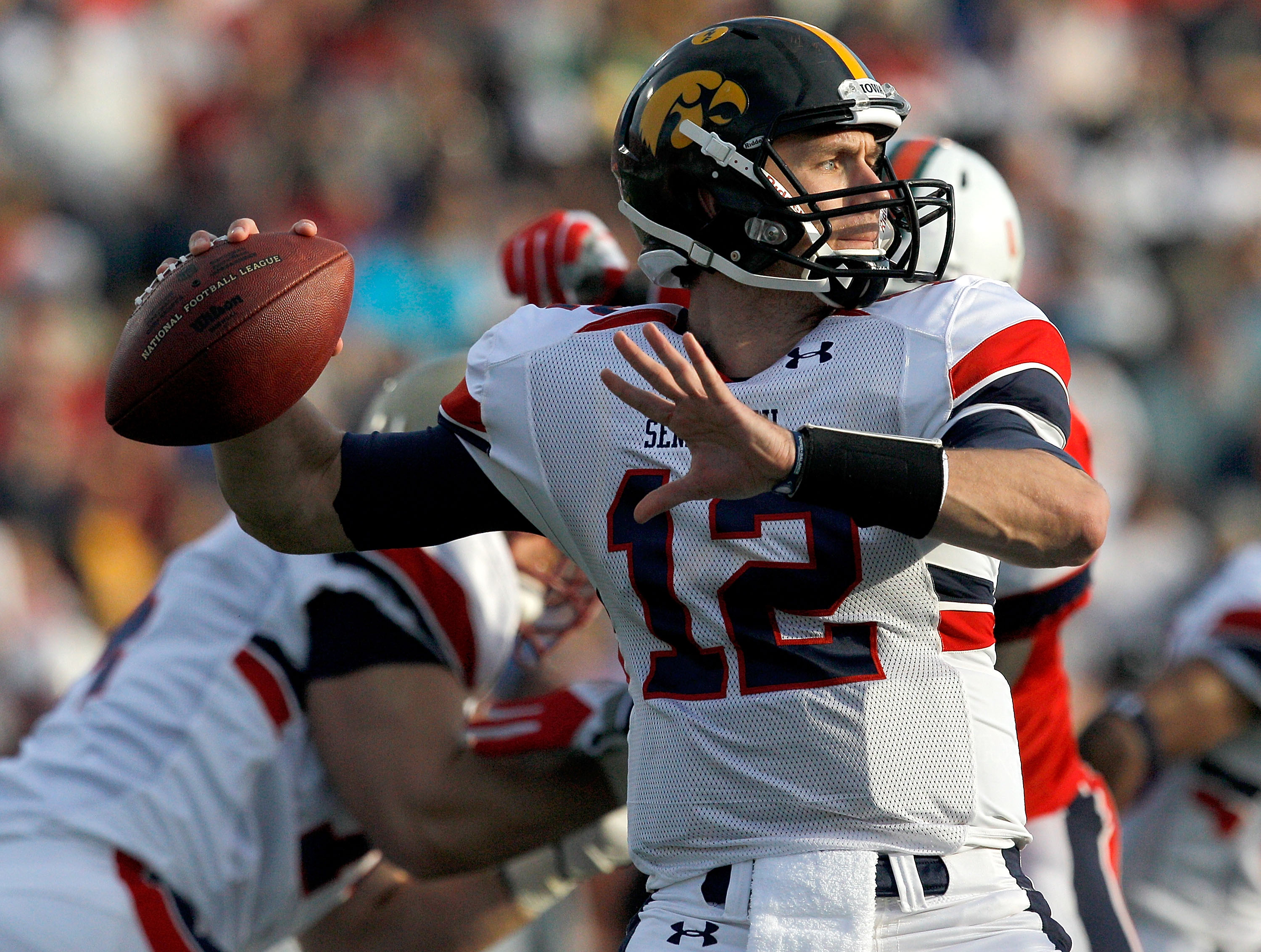 MOBILE, AL - JANUARY 29: Quarterback Ricky Stanzi #12 of the North Team passes over South Team defenders during second quarter of the Under Armour Senior Bowl on January 29, 2011 at Ladd Peebles Stadium in Mobile, Alabama.  (Photo by Sean Gardner/Getty Im
