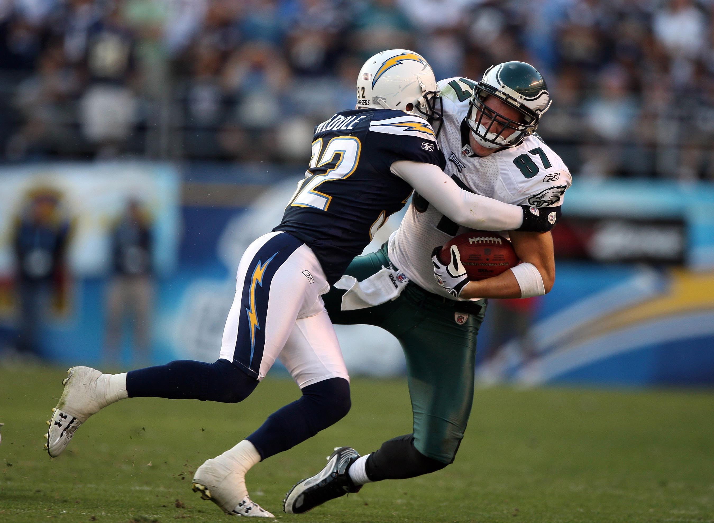 SAN DIEGO, CA - NOVEMBER 15:   Tight-End Brent Celek #87 of the Philadelphia Eagles is tackled after the catch by Eric Weddle #32 of the San Diego Chargers during the NFL football game on November 15, 2009 at Qualcomm Stadium in San Diego, California. Cha