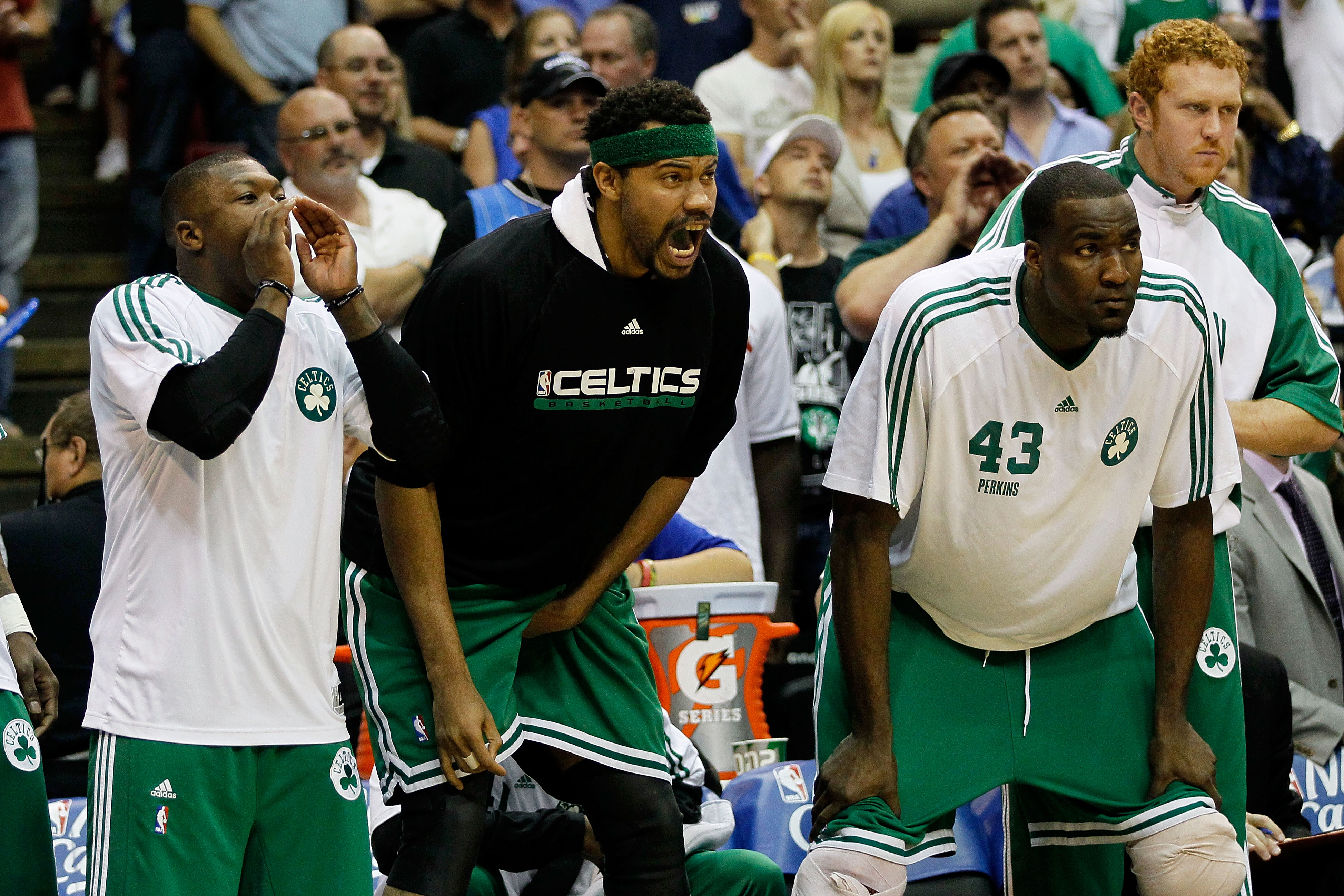 ORLANDO, FL - MAY 18:  (L-R) Nate Robinson #4, Rasheed Wallace #30 and Kendrick Perkins #43 of the Boston Celtics cheer on their teammates from the bench against the Orlando Magic in Game Two of the Eastern Conference Finals during the 2010 NBA Playoffs a