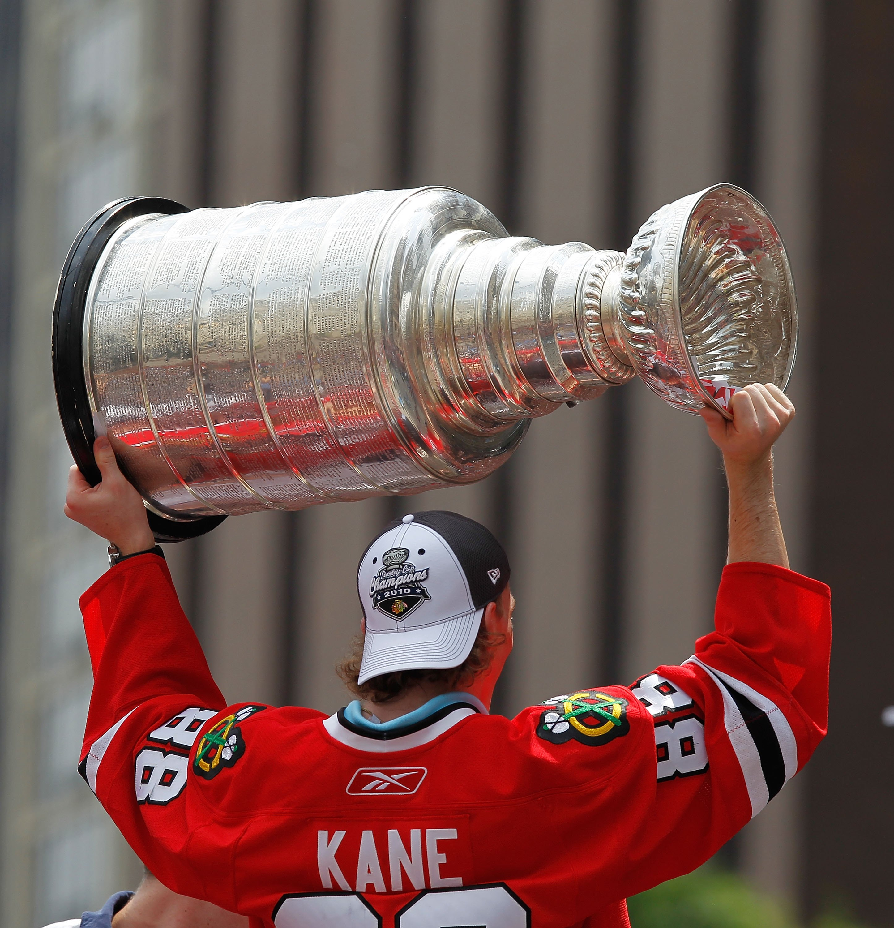 CHICAGO - JUNE 11: Patrick Kane #88 hoists the cup during the Chicago Blackhawks Stanley Cup victory parade and rally on June 11, 2010 in Chicago, Illinois. (Photo by Jonathan Daniel/Getty Images)