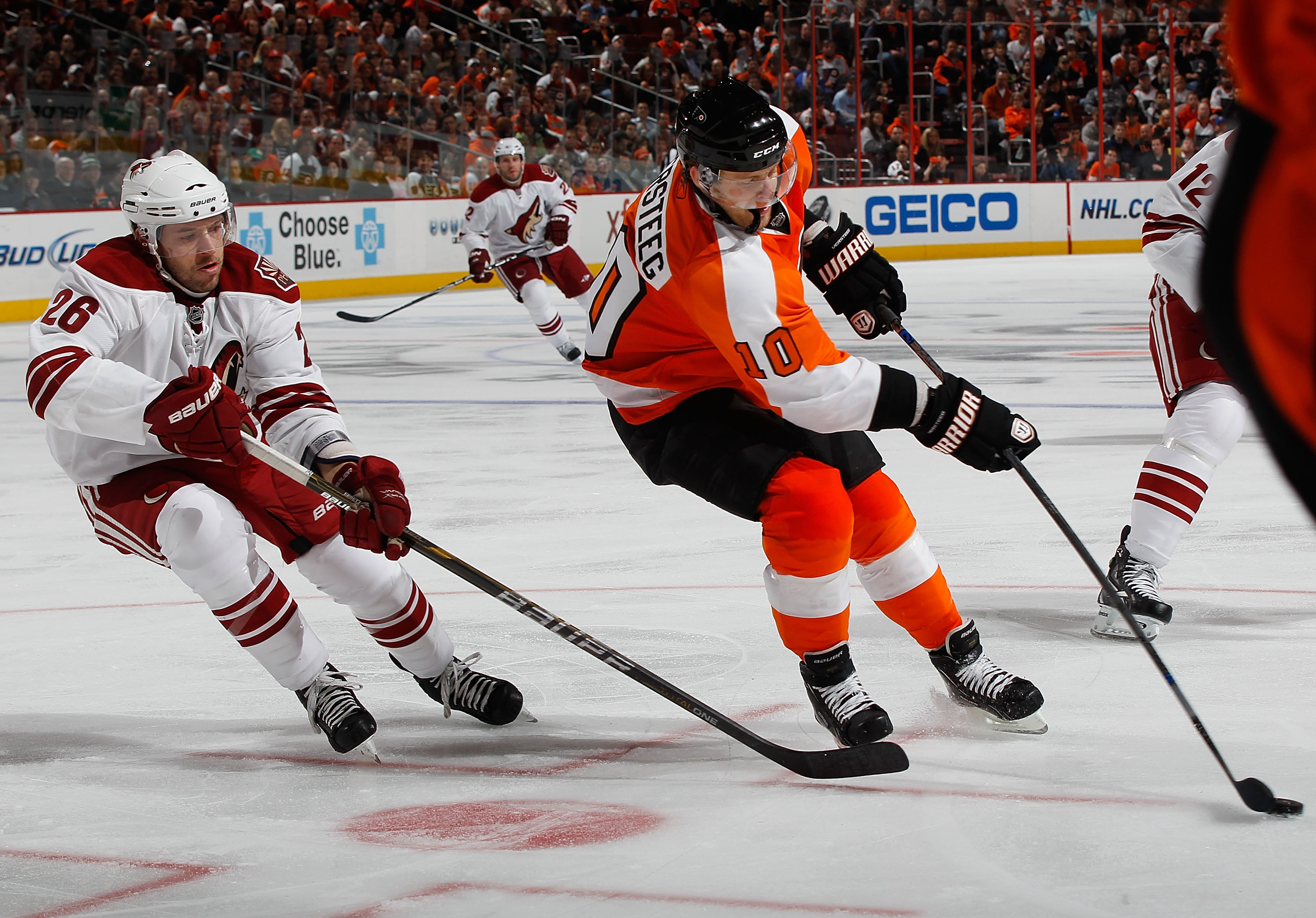 PHILADELPHIA - FEBRUARY 22:   Kris Versteeg #10 of the Philadelphia Flyers plays the puck in front of Andrew Ebbett #26 of the Phoenix Coyotes on February 22, 2011 at the Wells Fargo Center in Philadelphia, Pennsylvania. Coyotes defeat the Flyers 3-2 in O