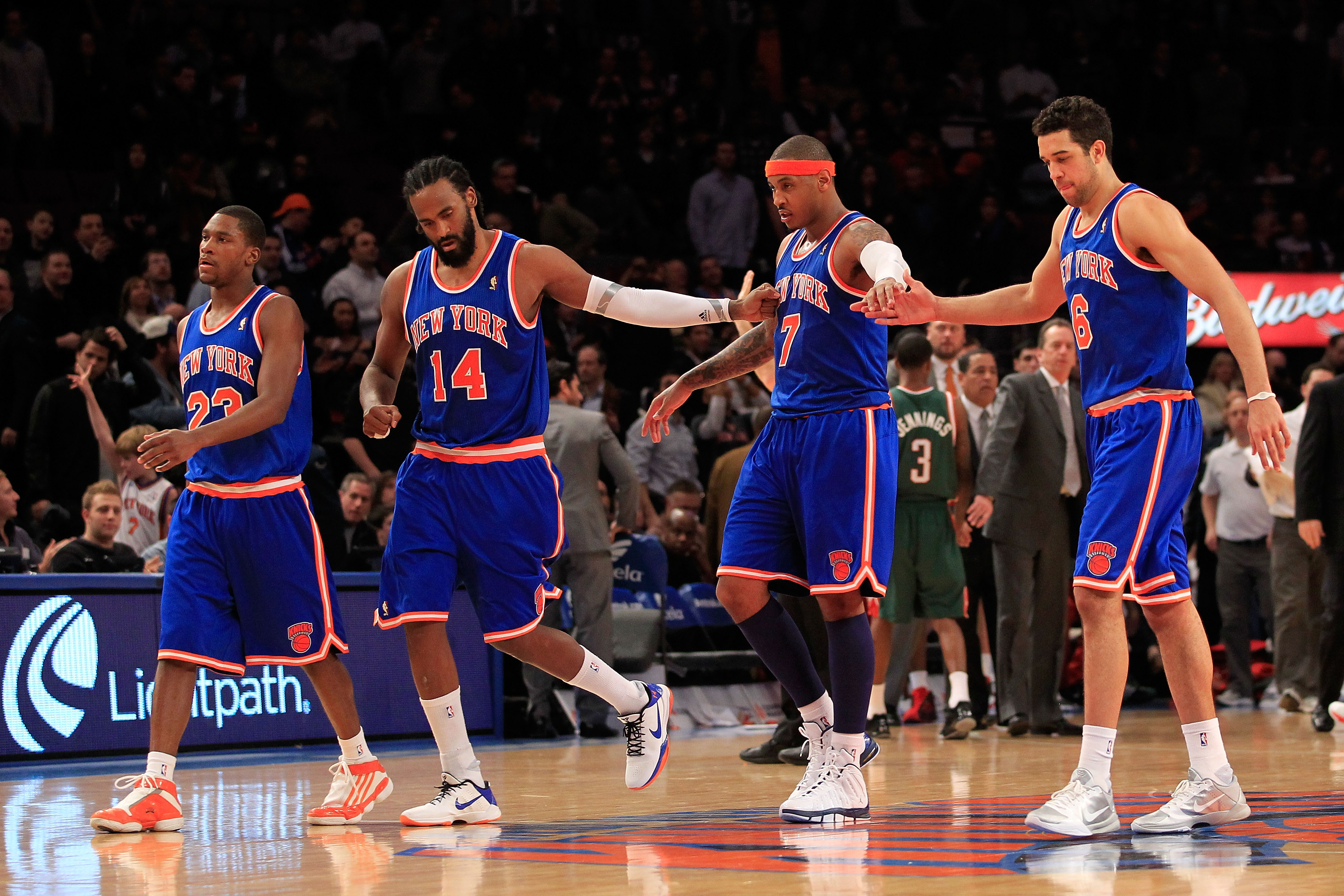 Melo to the Knicks is one trade being discussed in this article.