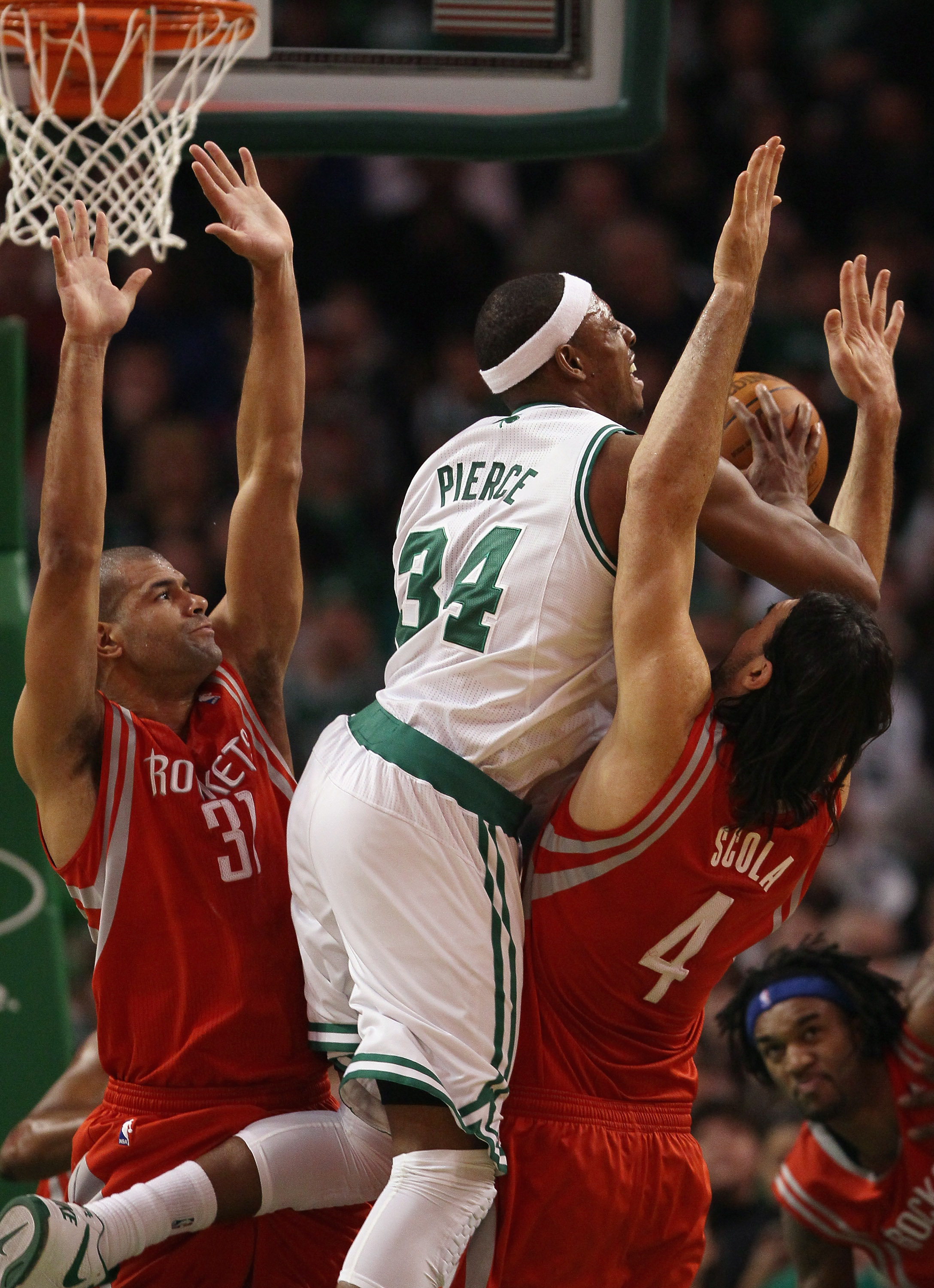 BOSTON, MA - JANUARY 10:  Paul Pierce #34 of the Boston Celtics tries to pass the ball as Shane Battier #31 and Luis Scola #4 of the Houston Rockets defend on January 10, 2011 at the TD Garden in Boston, Massachusetts.  The Rockets defeated the Celtics 10