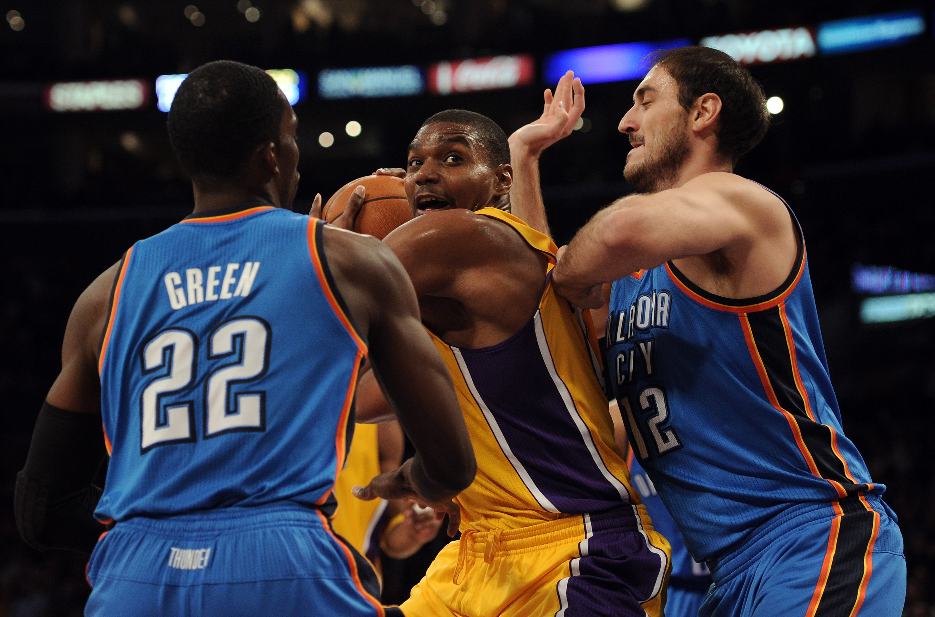 LOS ANGELES, CA - JANUARY 17:  Andew Bynum #17 of the Los Angeles Lakers looks for an opening between Nenad Kristic #12 and Jeff Green #22 of the Oklahoma City Thunder at the Staples Center on January 17, 2011 in Los Angeles, California.  (Photo by Harry